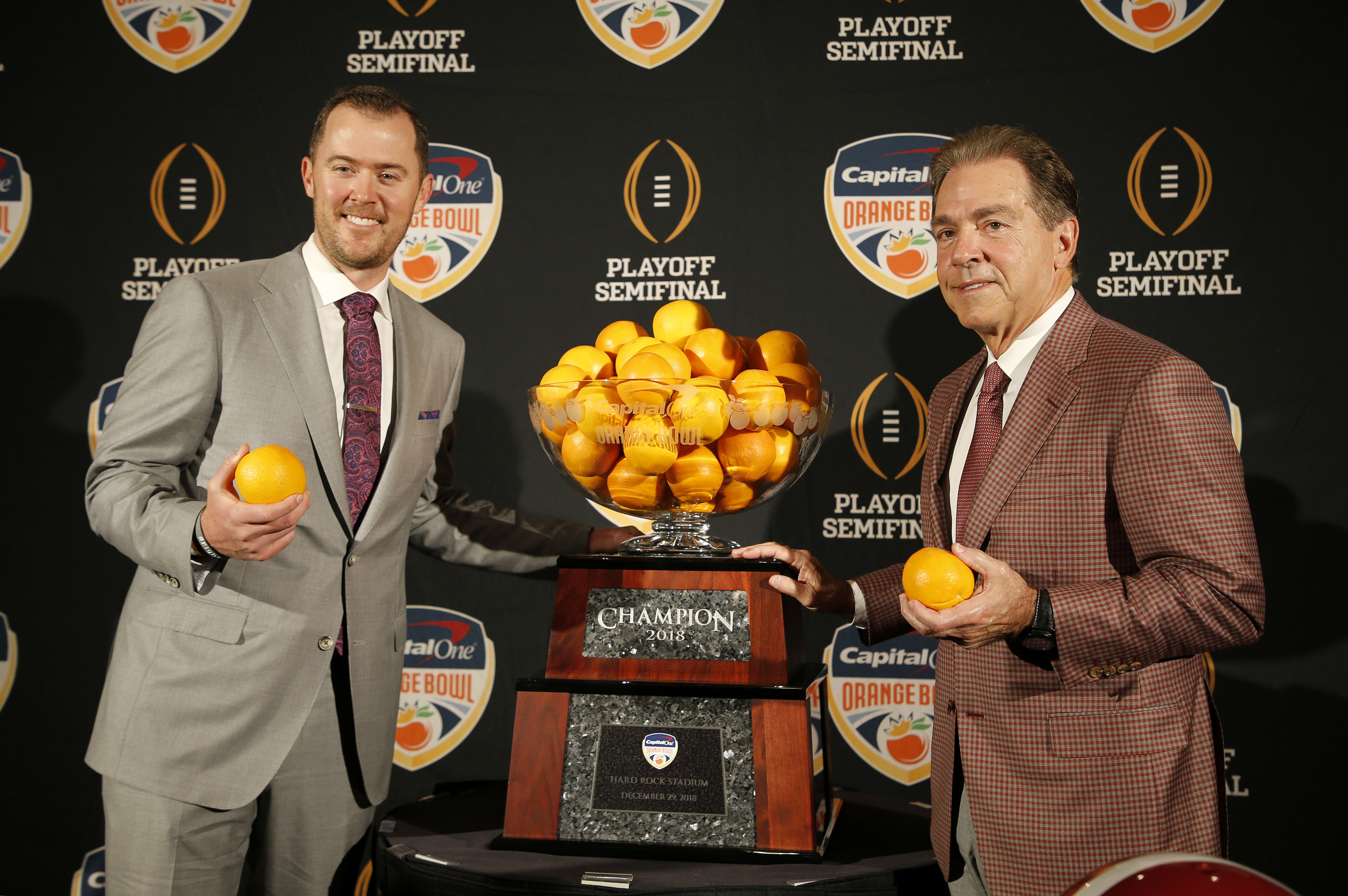 Alabama head coach Nick Saban, right, stands with Oklahoma head coach Lincoln Riley at an NCAA college football news conference in Fort Lauderdale, Fla., Friday, Dec. 28, 2018. Alabama plays Oklahoma in the Orange Bowl on Saturday, Dec. 29. (AP Photo/Joe Skipper)