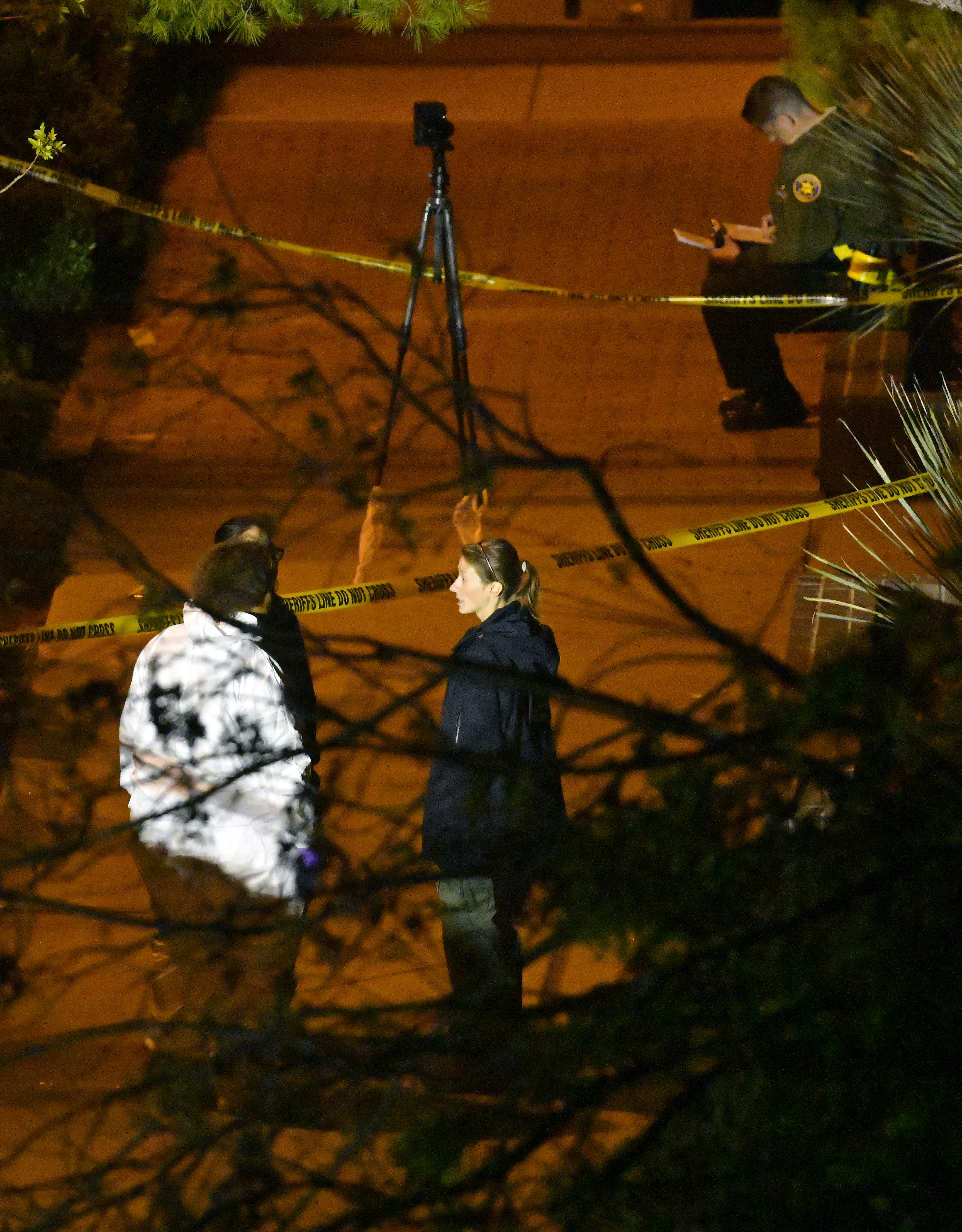 A forensics team works the scene Thursday, Nov. 8, 2018, in Thousand Oaks, Calif. where a gunman opened fire Wednesday inside a country dance bar crowded with hundreds of people on