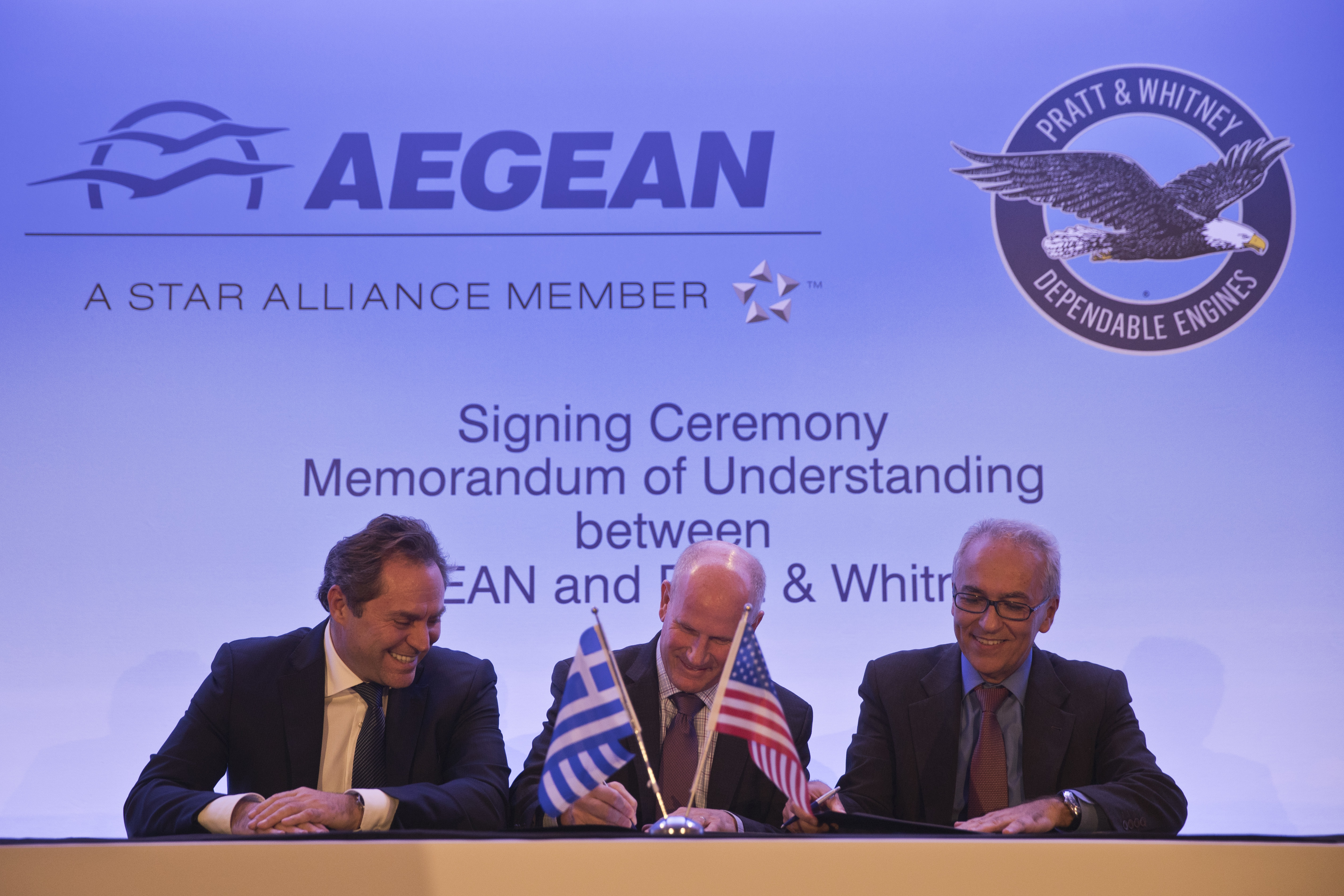 Chairman of Aegean Airlines Eftychios Vassilakis, left, Rick Deurloo Senior Vice President - Sales, Marketing and Customer Support at Pratt & Whitney and Aegean Airlines CEO Dimitrios Gerogiannis, right, sign a memorandum of understanding for the purchase of up to 130 new Pratt & Whitney engines for the Greek company's new Airbus passenger jets in Athens, on Wednesday, Dec. 5, 2018. The deal, once concluded, is expected to be worth up to US dollars 1.5 billion. (AP Photo/Petros Giannakouris)