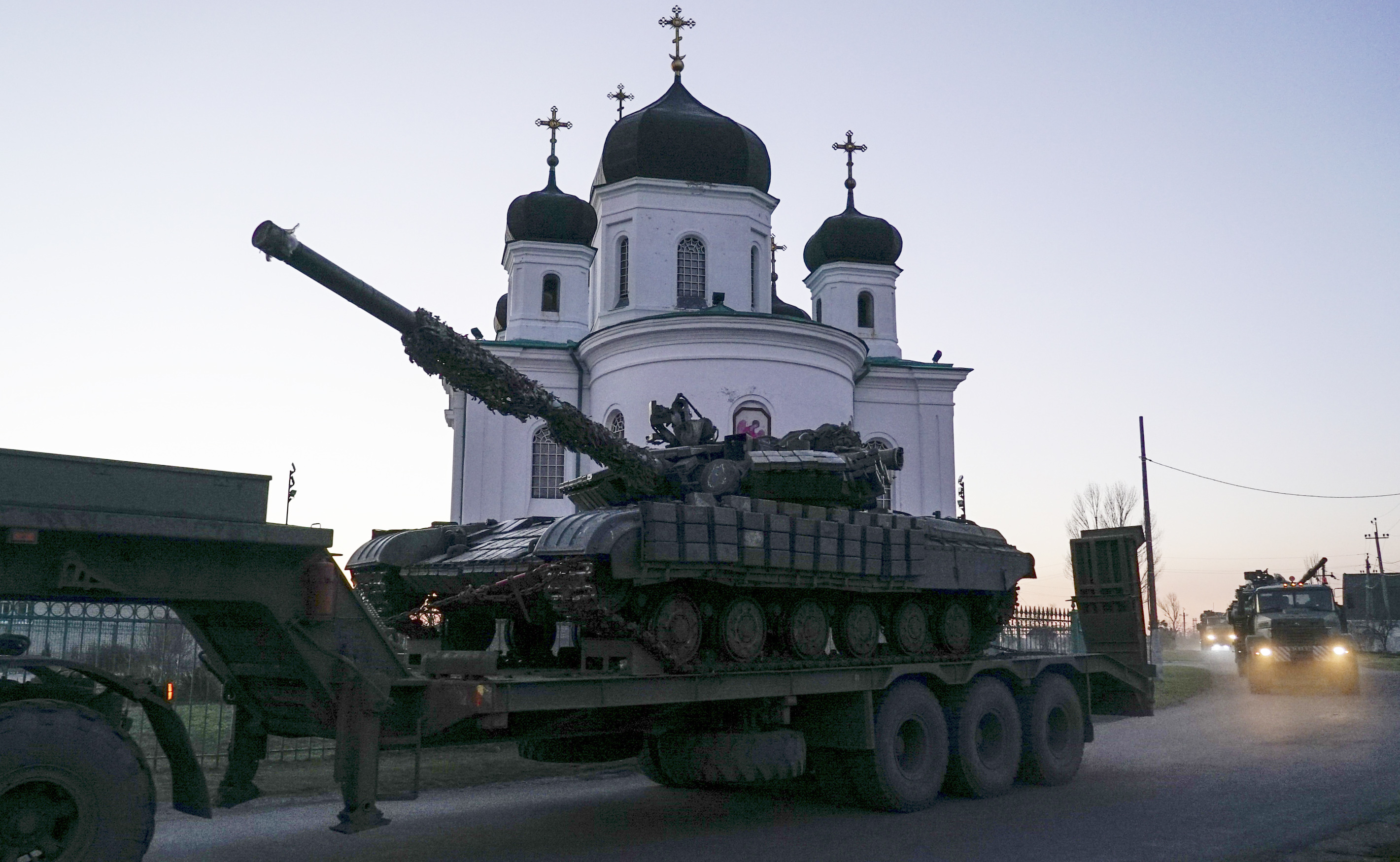 Ukrainian tanks are being transported in Urzuf, south coast of Azov sea, eastern Ukraine, Thursday, Nov. 29, 2018. Ukraine put its military forces on high combat alert and announced martial law this week after Russian border guards fired on and seized three Ukrainian ships in the Black Sea. (AP Photo/Evgeniy Maloletka)