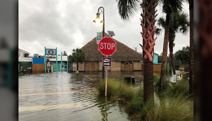 The St. Marks River overflows into the city of St. Marks, FL, ahead of Hurricane Michael, Wednesday, Oct. 10. (AP Photo/Brendan Farrington)