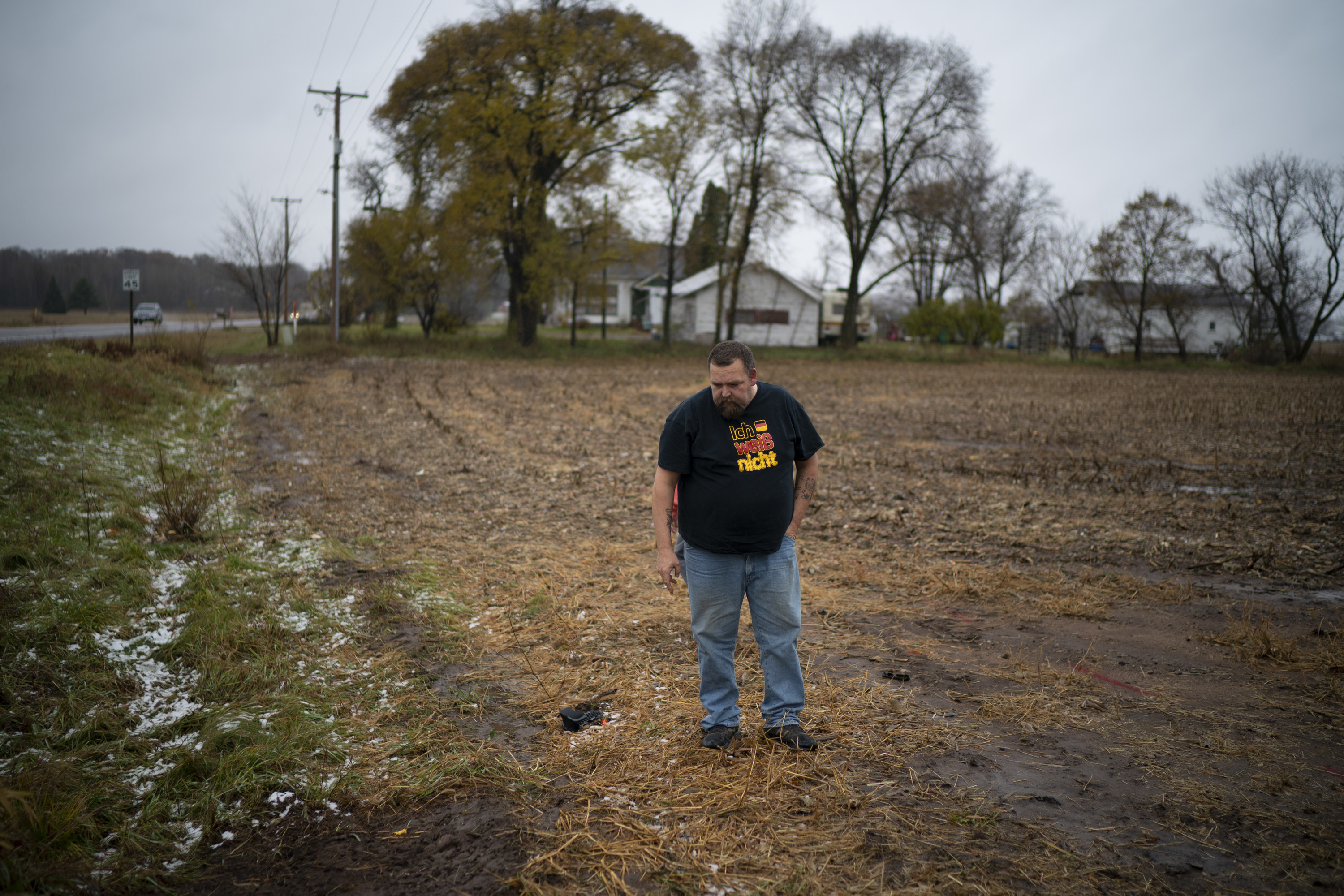 A relative of the adult victim struck and killed by a vehicle Saturday looks at the path he thought the truck took when it veered off Wisconsin County Hwy. P, Sunday, Nov. 4, 2018. The western Wisconsin community is grieving the deaths of three Girl Scouts and an adult who were collecting trash along a rural highway when police say a pickup truck veered off the road and hit them before speeding away. (Jeff Wheeler/Star Tribune via AP)