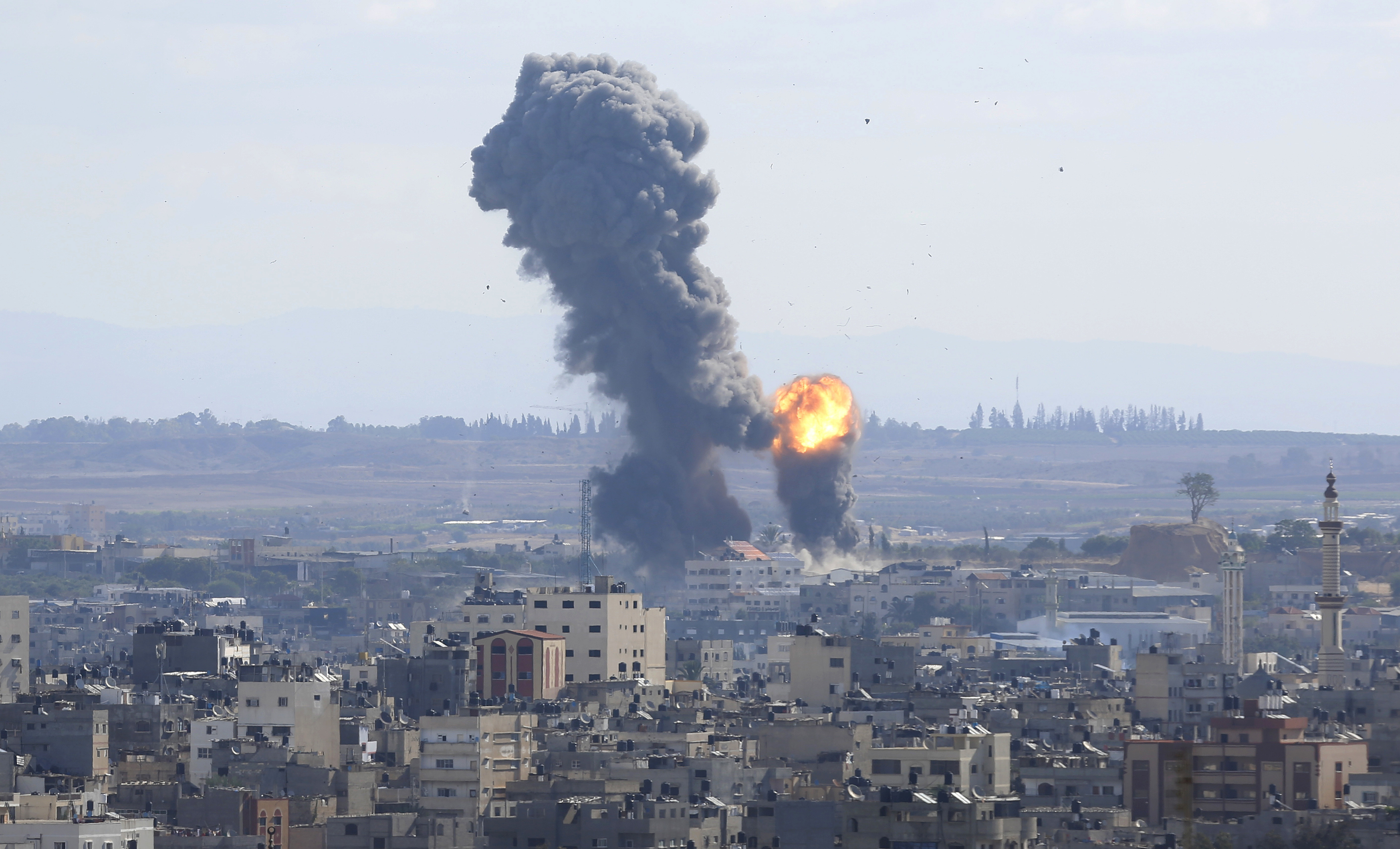 Smoke rises from an explosion caused by an Israeli airstrike in Gaza City, Saturday, Oct. 27, 2018. Israeli aircraft struck several militant sites across the Gaza Strip early Saturday shortly after militants fired rockets into southern Israel, the Israeli military said. (AP Photo/Hatem Moussa)