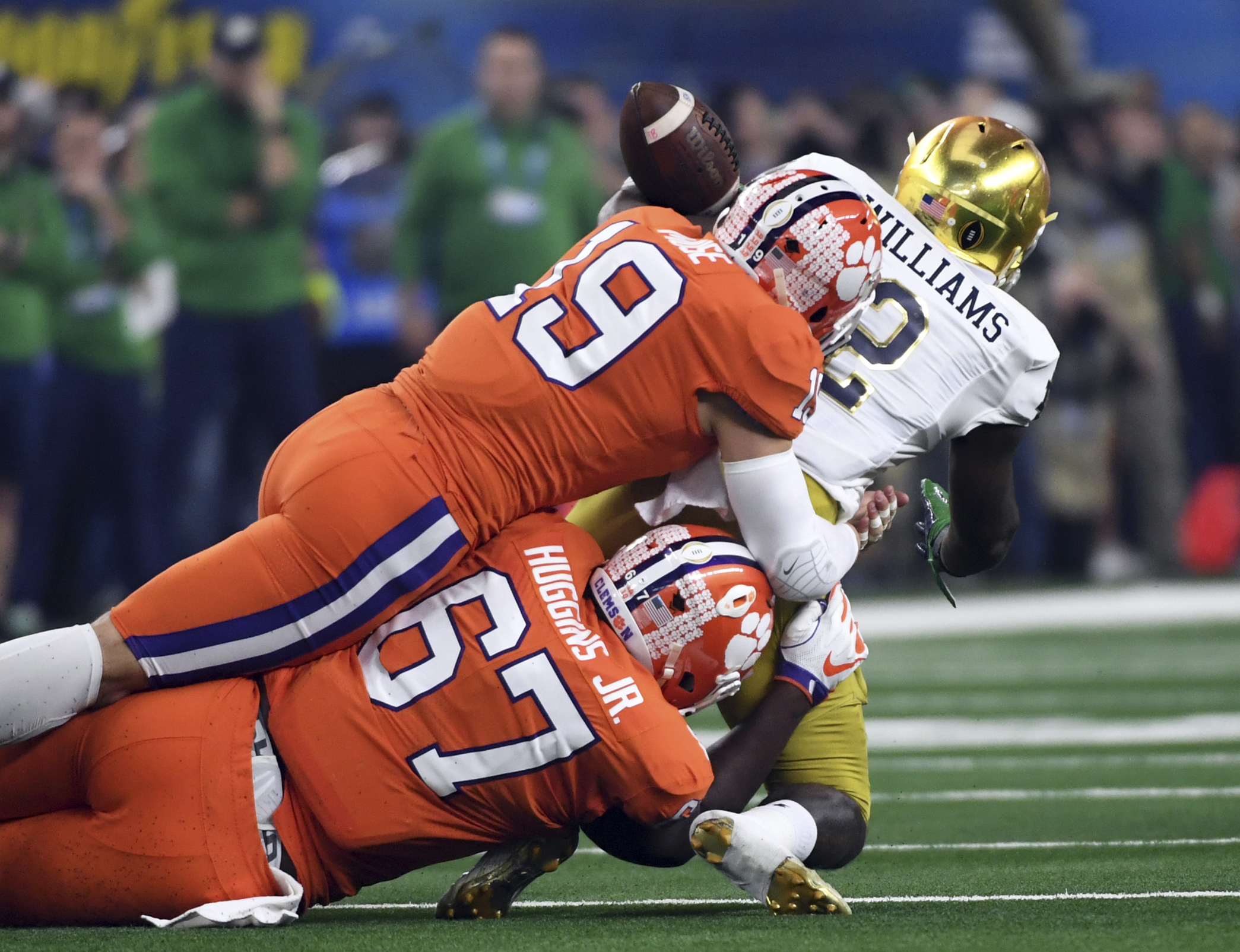 Clemson safety Tanner Muse (19) and defensive tackle Albert Huggins (67) combine to strip the ball away from Notre Dame running back Dexter Williams (2) in the first half of the NCAA Cotton Bowl semi-final playoff football game, Saturday, Dec. 29, 2018, in Arlington, Texas. (AP Photo/Jeffrey McWhorter)