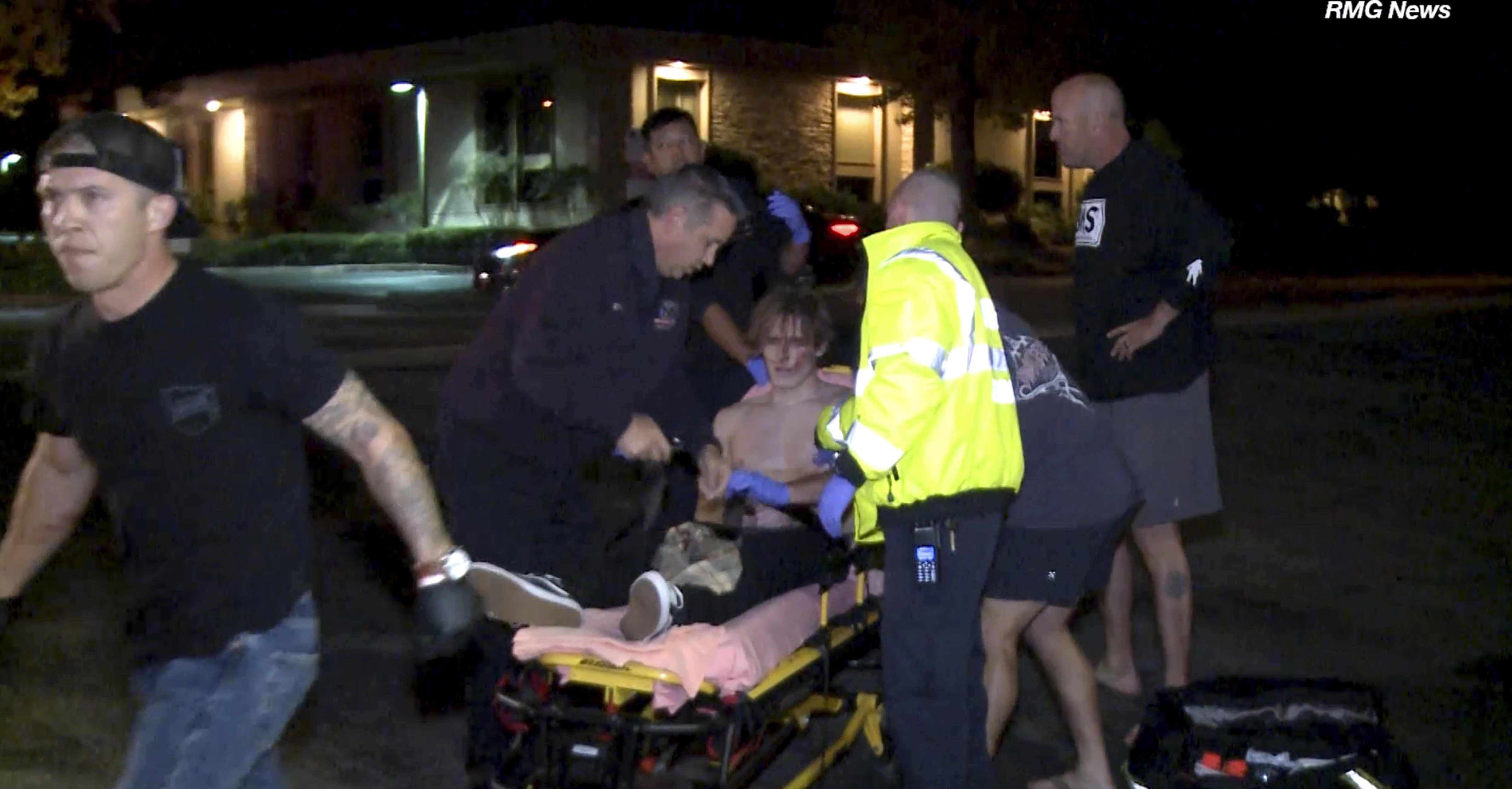 In this image taken from video a victim is treated near the scene of a shooting, Wednesday evening, Nov. 7, 2018, in Thousand Oaks, Calif. A hooded gunman dressed entirely in black opened fire on a crowd at a country dance bar holding a weekly