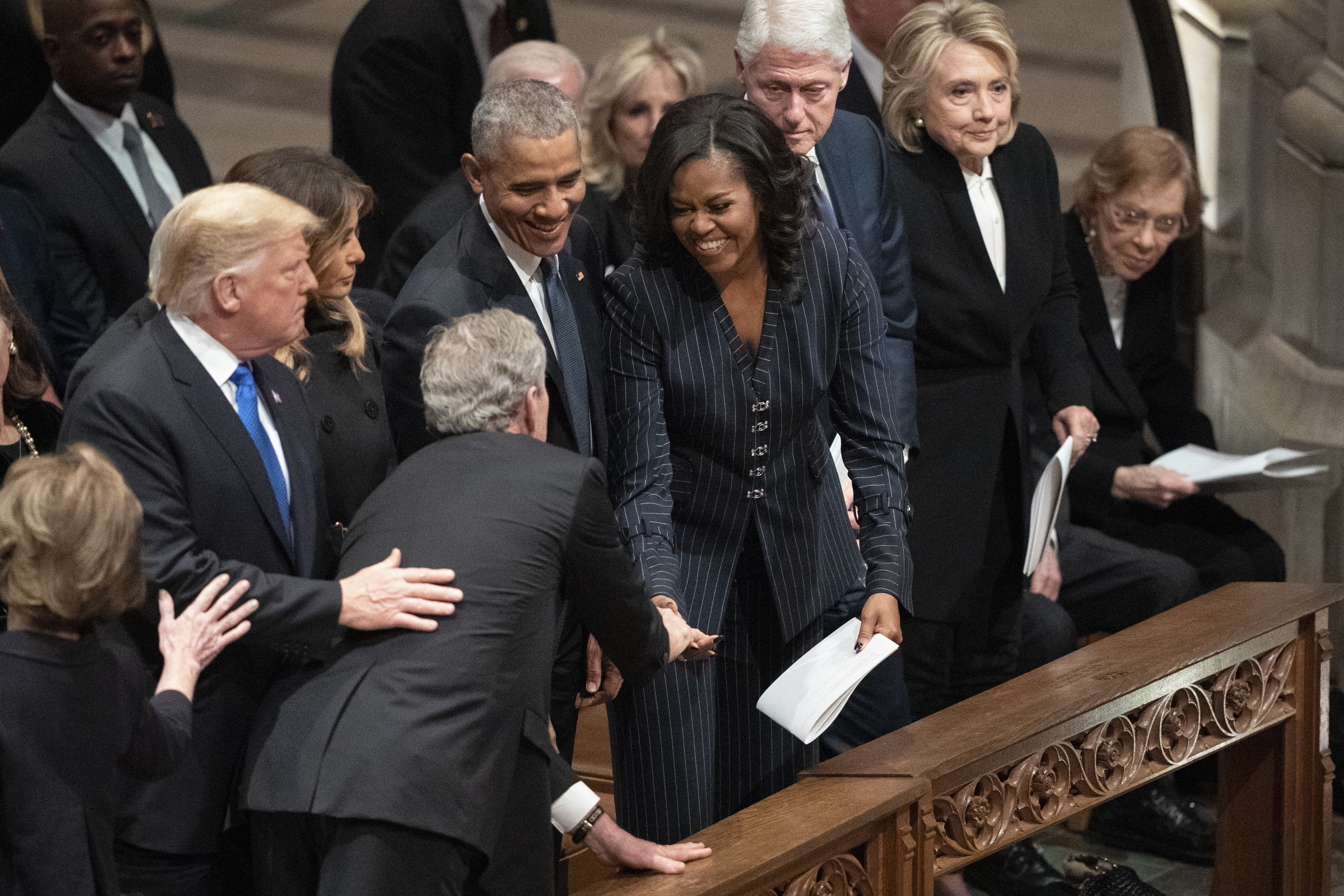 President George W. Bush and wife Laura Bush greets President Donald Trump, first lady Melania Trump, former President Barack Obama, Michelle Obama, former President Bill Clinton, former Secretary of State Hillary Clinton, former President Jimmy Carter, and Rosalynn Carter during a State Funeral for former President George H.W. Bush at the National Cathedral, Wednesday, Dec. 5, 2018, in Washington.(AP Photo/Carolyn Kaster)