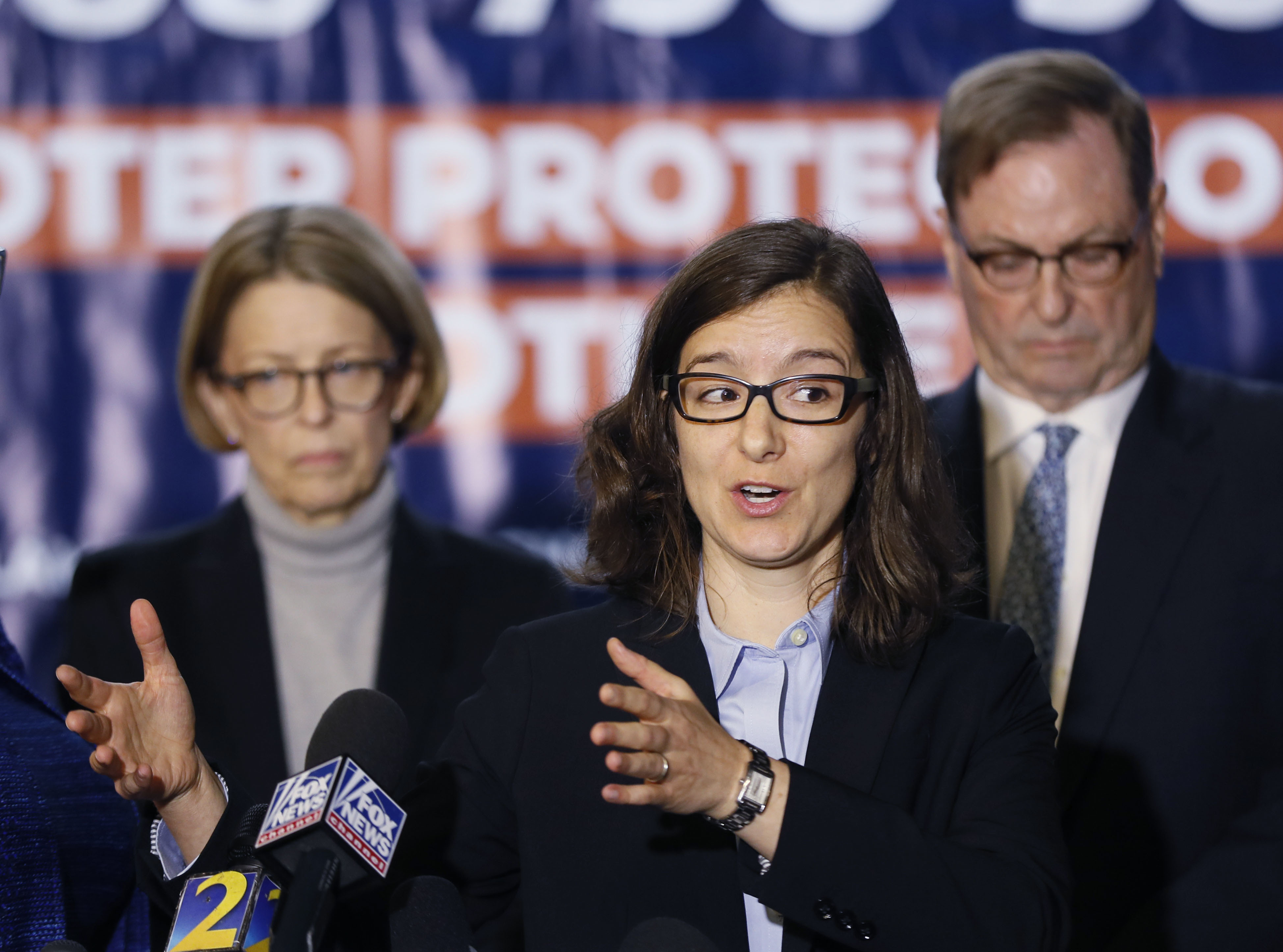 Lauren Groh-Wargo, Stacey Abrams' campaign manager, stands with attorneys as she speaks at a news conference Thursday, Nov. 8, 2018, in Atlanta. Republican Brian Kemp resigned Thursday as Georgia's secretary of state, a day after his campaign said he's captured enough votes to become governor despite his rival's refusal to concede. Abrams' campaign immediately responded by refusing to accept Kemp's declaration of victory in the race and demanding that state officials