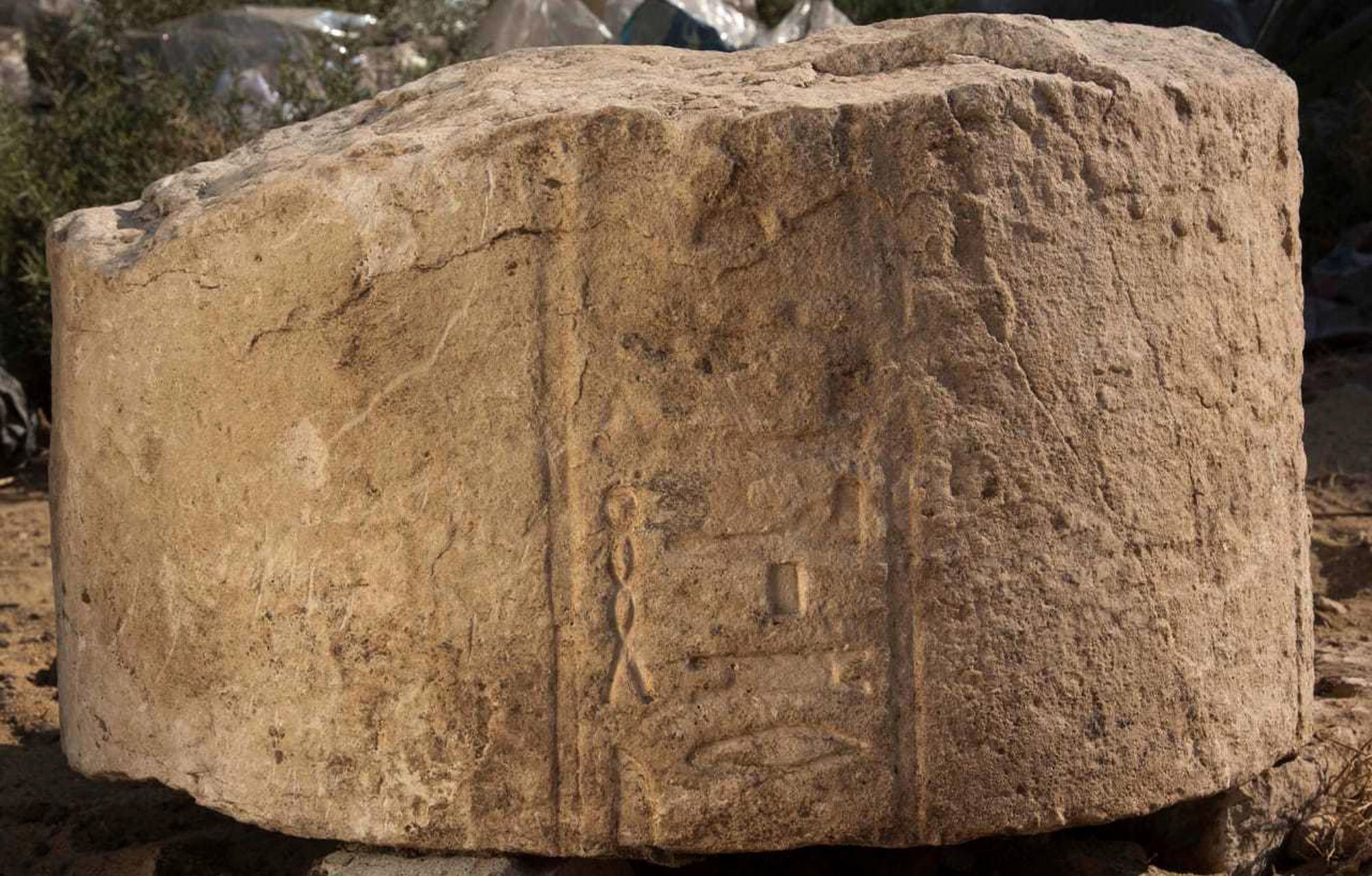 This undated photo released by the Egyptian Ministry of Antiquities, shows part of a stone slab tht was discovered at a dig in eastern Cairo's Matariya neighborhood, Egypt. The Antiquities Ministry said on Tuesday, Nov. 6, 2018, that archeologists working at the dig have found several fragments of stone slabs with inscriptions dating back up to 4,000 years. Some of the fragments date back to the 12th and the 20th Dynasties and the Third Intermediate Period while others are more recent. (Egyptian Ministry of Antiquities via AP)