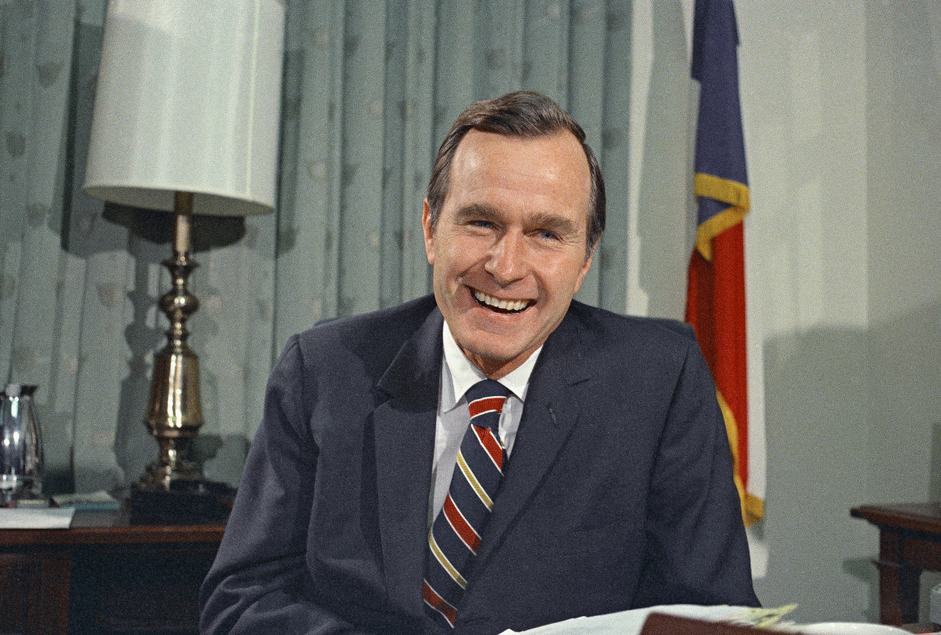 In this Dec. 18, 1970, photo, newly appointed United Nations Ambassador George H.W. Bush smiles. (AP Photo/John Duricka, File)