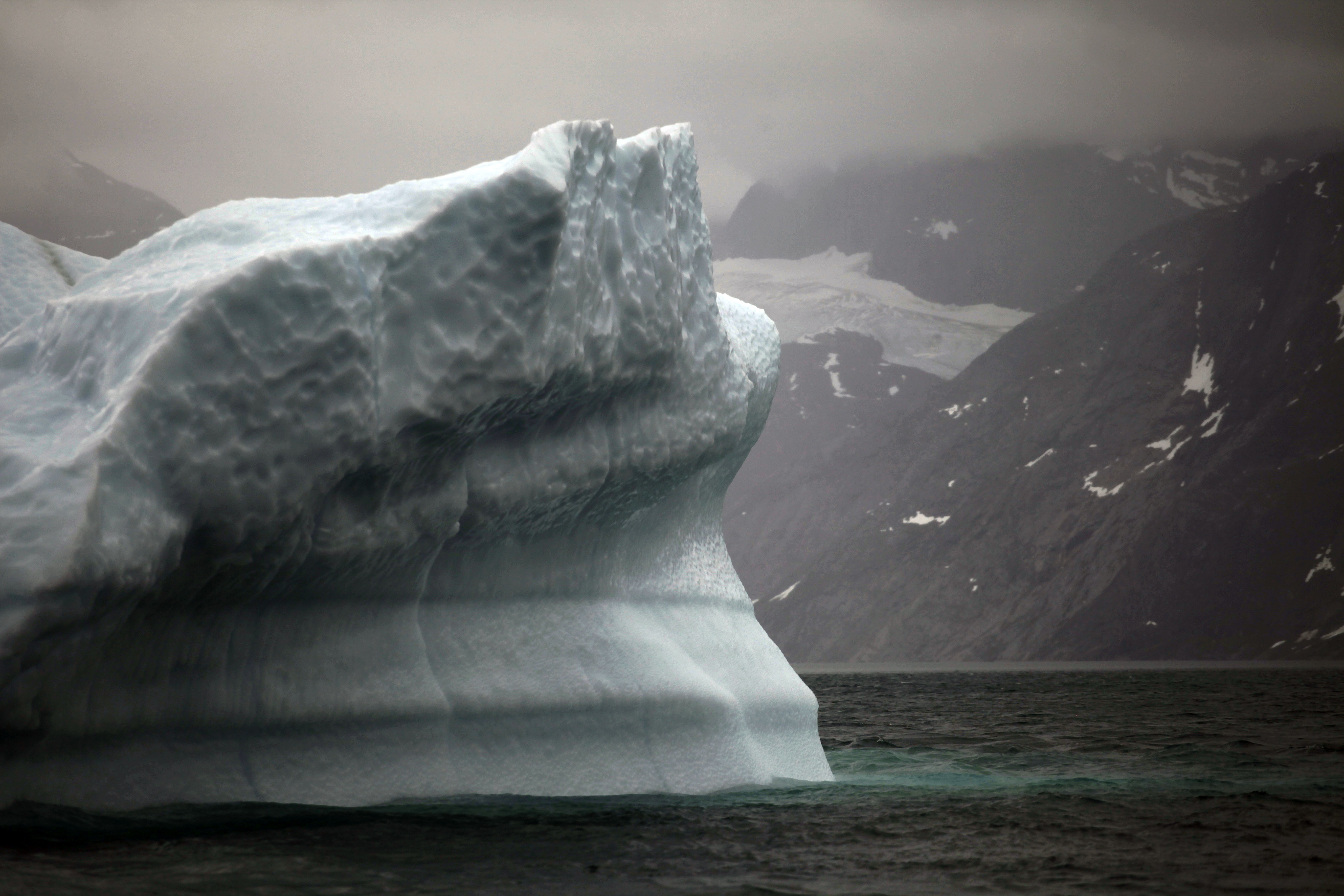 FILE- In this July 26, 2011 photo, a melting iceberg floats along a fjord leading away from the edge of the Greenland ice sheet near Nuuk, Greenland. The COP 24 UN Climate Change Conference is taking place in Katowice, Poland. Negotiators from around the world are meeting for talks on curbing climate change. (AP Photo/Brennan Linsley, File)