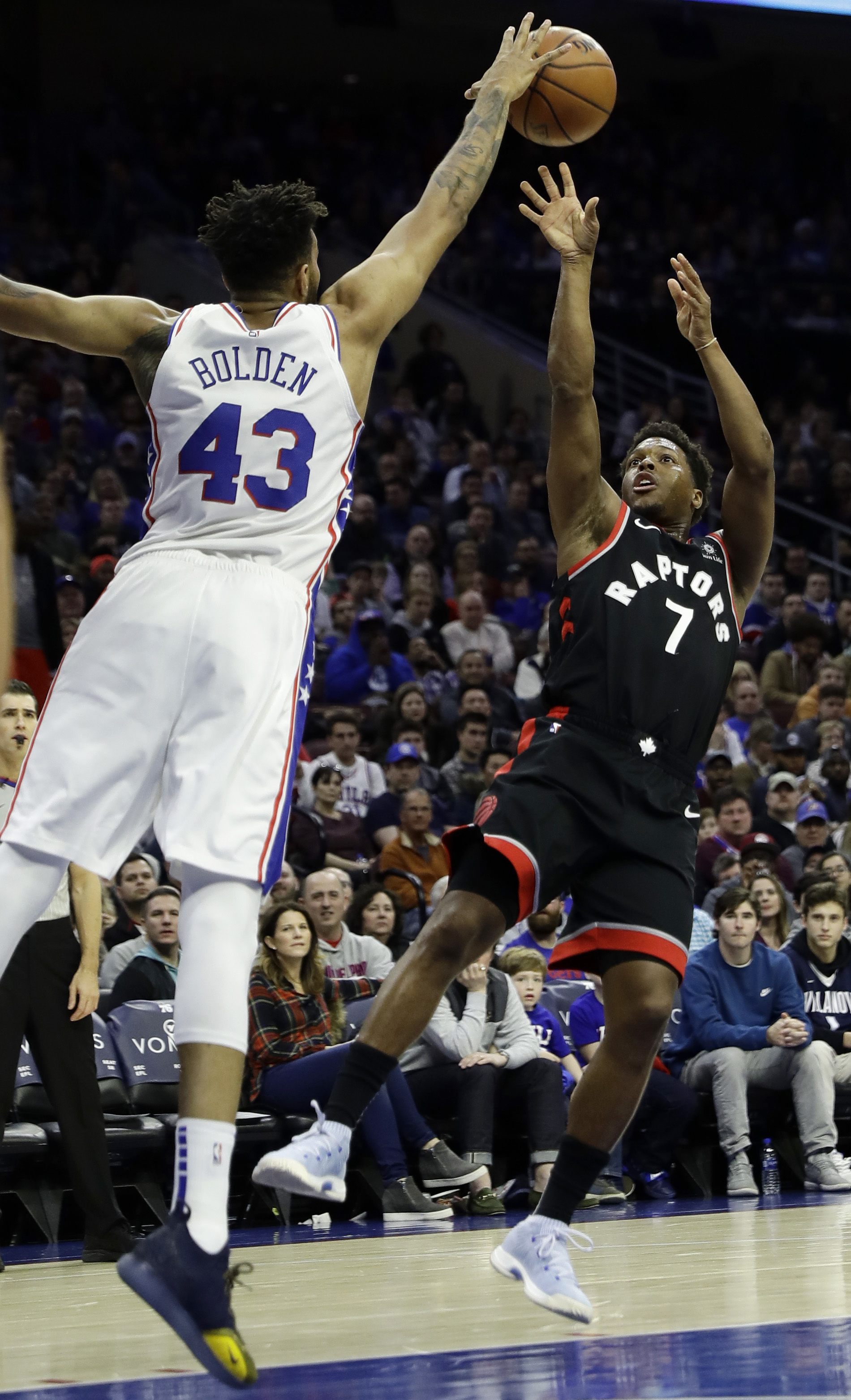 Toronto Raptors' Kyle Lowry, right, cannot get a shot past Philadelphia 76ers' Jonah Bolden during the first half of an NBA basketball game, Saturday, Dec. 22, 2018, in Philadelphia. (AP Photo/Matt Slocum)