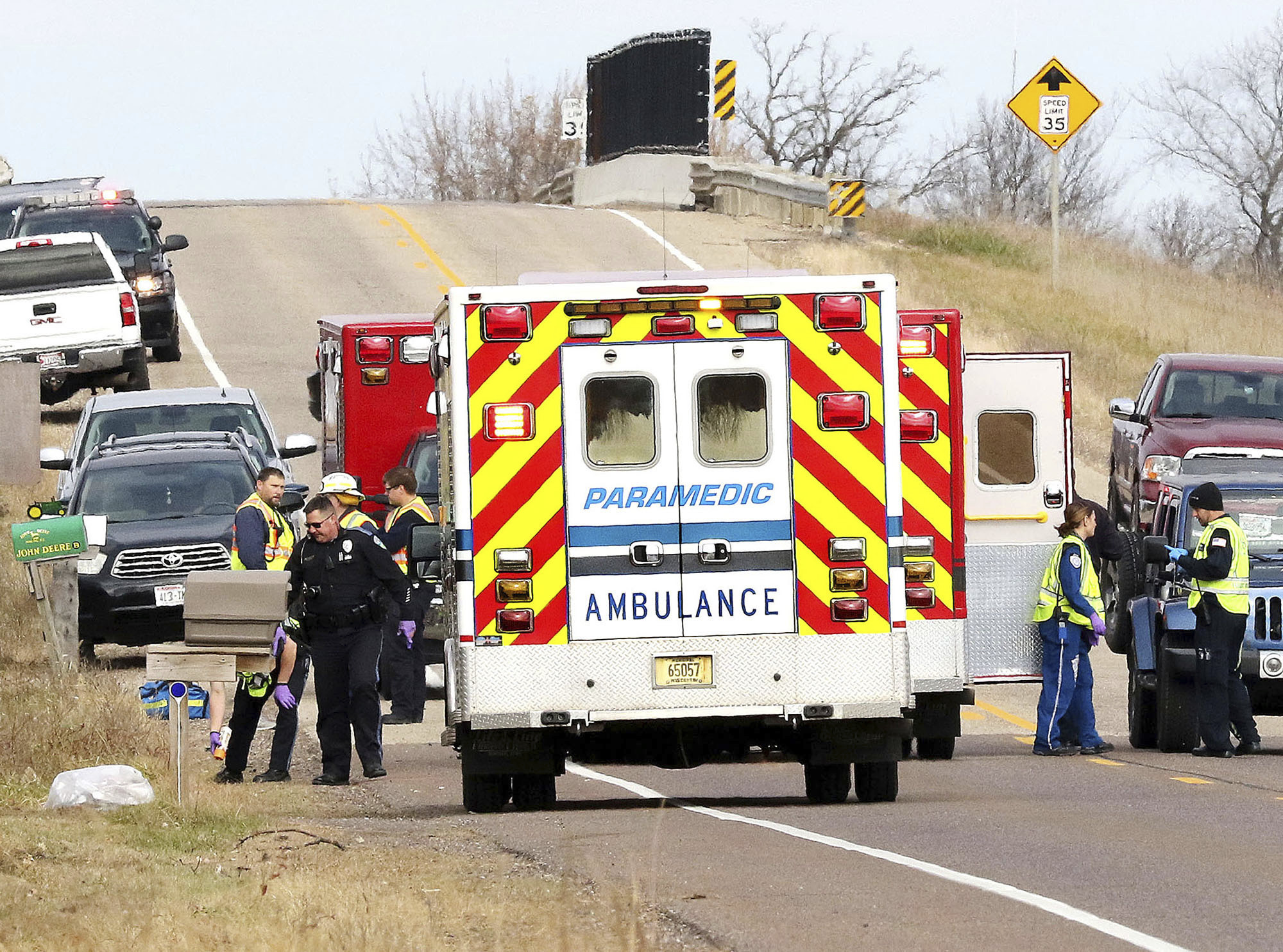 Emergency medical personnel gather at the scene of a hit-and-run accident Saturday, Nov. 3, 2018, in Lake Hallie, Wis., that killed two girls and an adult. (Steve Kinderman/The Eau Claire Leader-Telegram via AP)