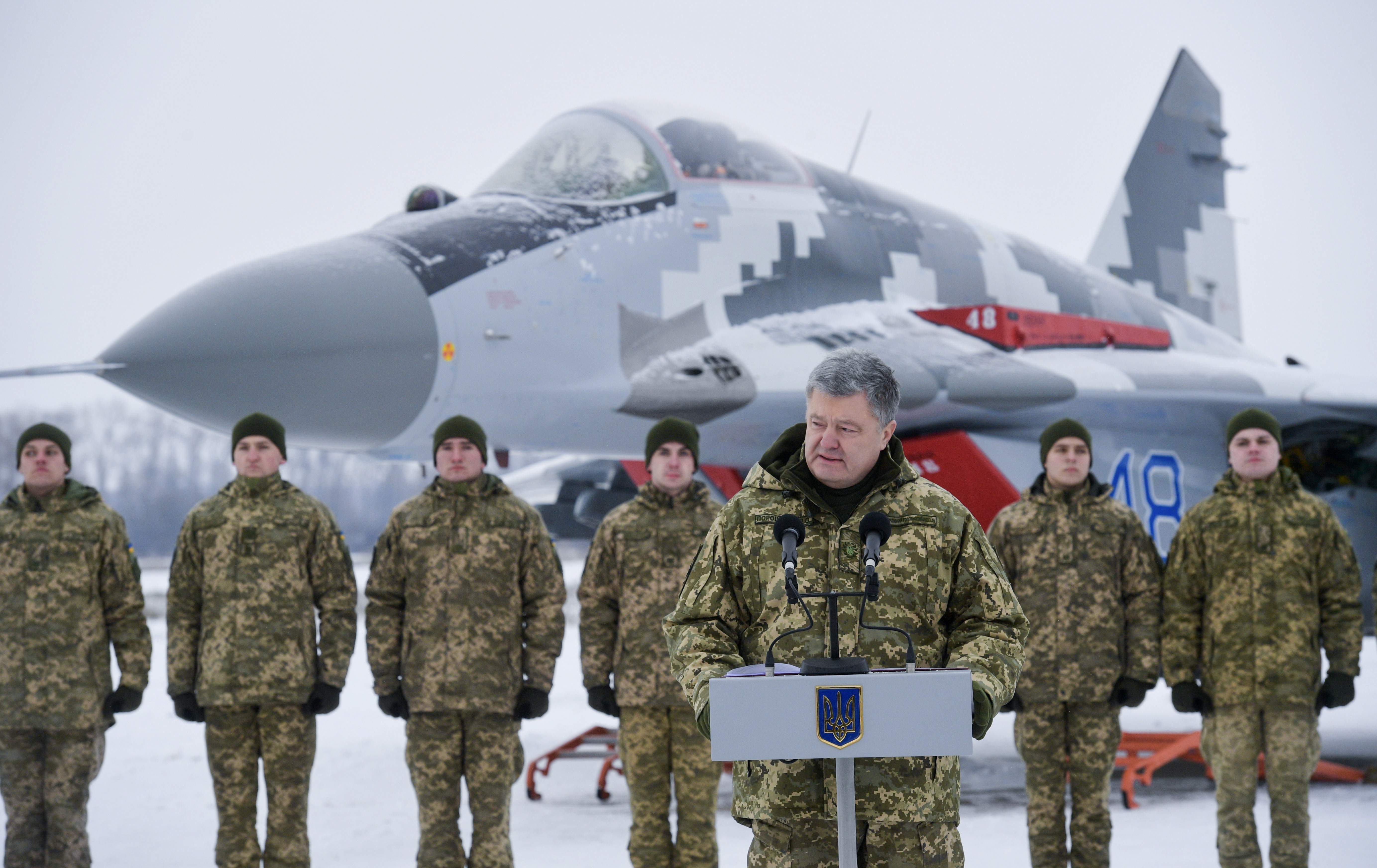Ukrainian President Petro Poroshenko addresses the Armed Forces of Ukraine at the military airfield in Vasylkiv region, Ukraine, Saturday, Dec. 1, 2018, as Poroshenko transferred new aircraft and military equipment to the Ukrainian Armed Forces as part of his working visit. Russia and Ukraine traded blame as tensions between the neighbouring countries have escalated over recent days. (Mykola Lazarenko, Presidential Press Service via AP)