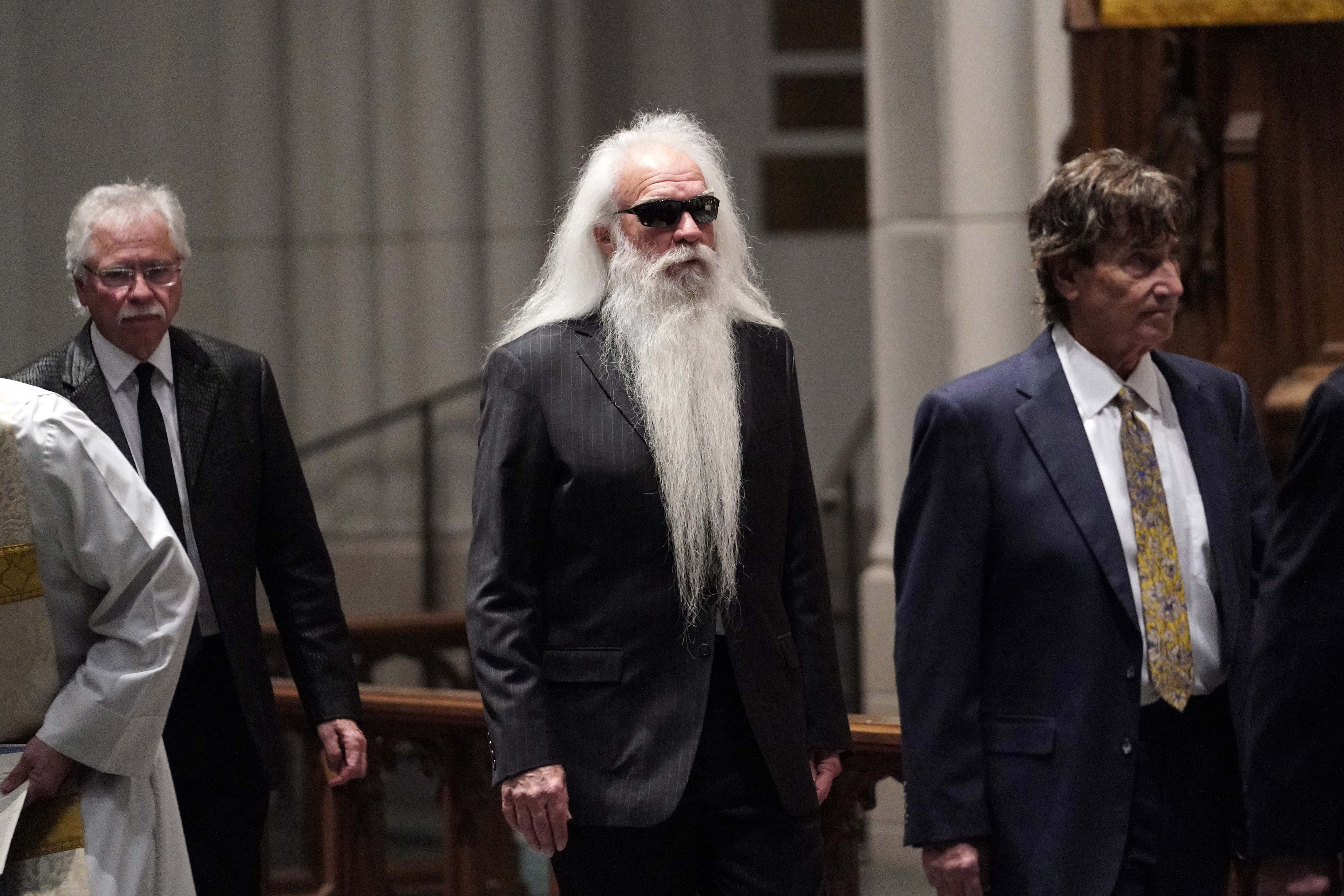 Members of the Oak Ridge Boys arrive for a funeral service for former President George H.W. Bush at St. Martin's Episcopal Church Thursday, Dec. 6, 2018, in Houston. (AP Photo/David J. Phillip, Pool)
