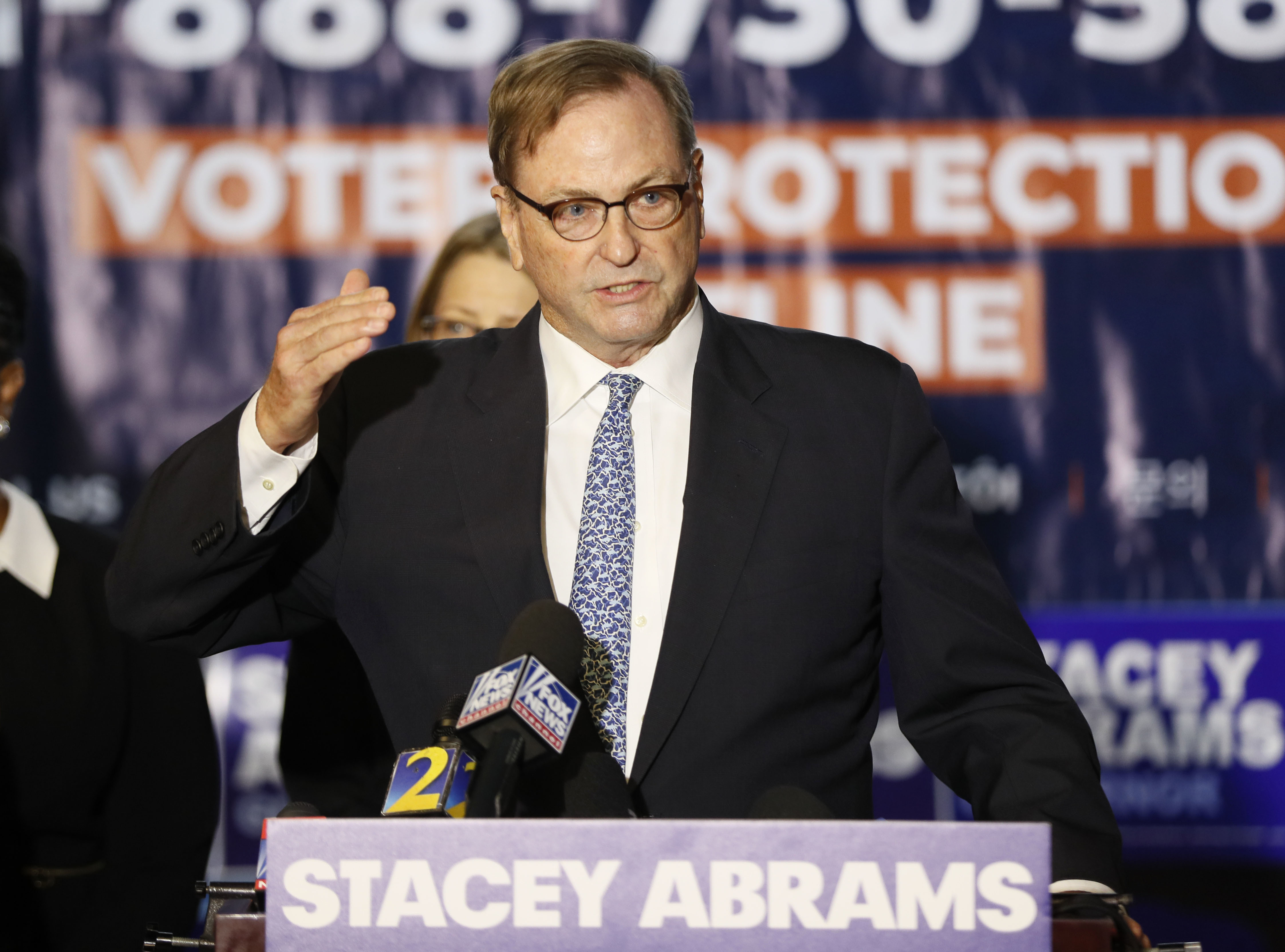 John Chandler, one of Stacey Abrams' attorneys, speaks during a news conference Thursday, Nov. 8, 2018, in Atlanta. Republican Brian Kemp resigned Thursday as Georgia's secretary of state, a day after his campaign said he's captured enough votes to become governor despite his rival's refusal to concede. Abrams' campaign immediately responded by refusing to accept Kemp's declaration of victory in the race and demanding that state officials