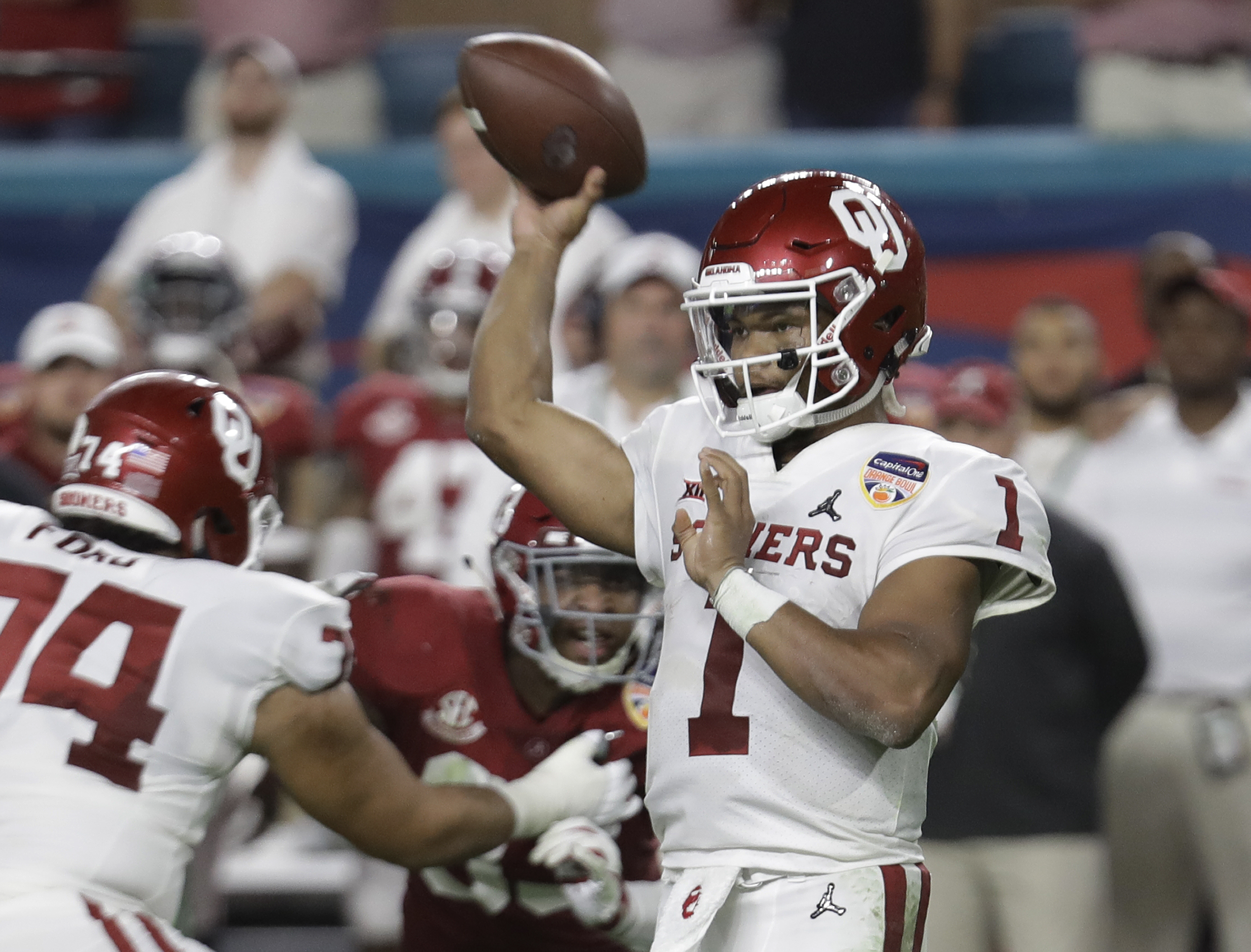 Oklahoma quarterback Kyler Murray (1) looks to pass, during the first half of the Orange Bowl NCAA college football game against Alabama, Saturday, Dec. 29, 2018, in Miami Gardens, Fla. (AP Photo/Lynne Sladky)