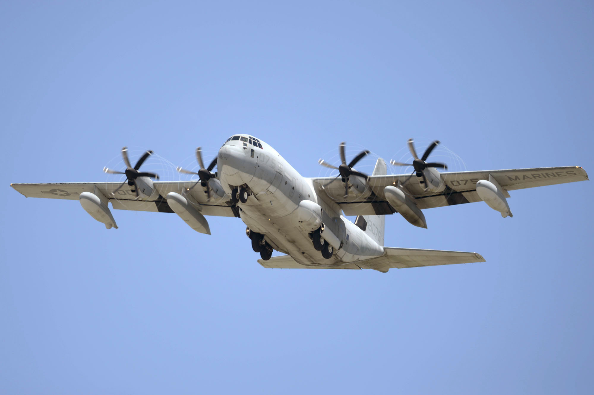 """This July, 2014, photo shows a U.S. Marine Corps' KC-130 refueling plane in Ginowan city, Okinawa, southwestern Japan. A search is under way off for crew members from two Marine Corps planes, a F/A-18 and a refueling plane, involved in what officials called a """"mishap"""" off the coast of Japan, Thursday, Dec. 6, 2018. (Yuki Sato/Kyodo News via AP)"""