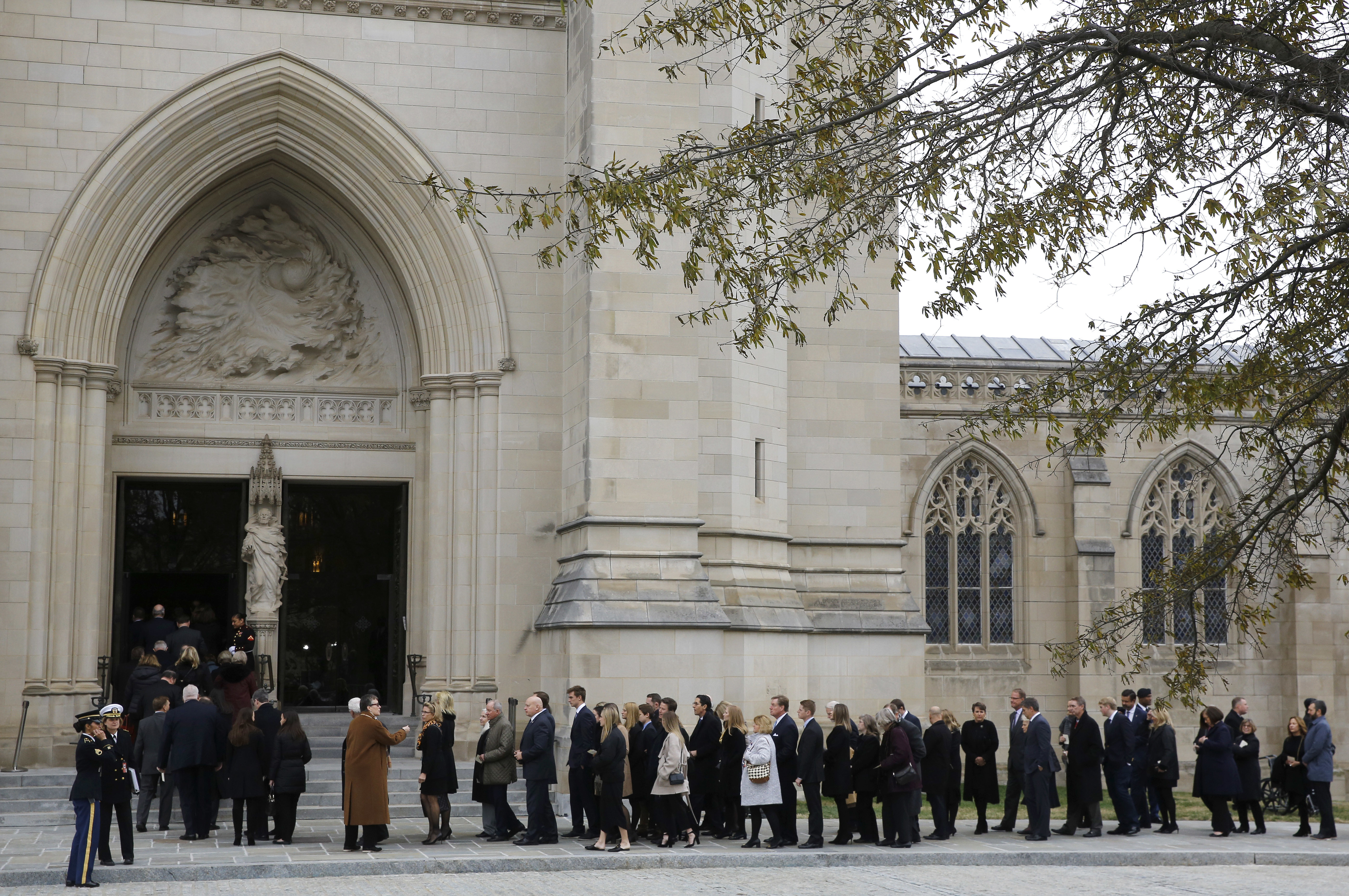 Mourners file into the Washington National Cathedral before the State Funeral for former President George H.W. Bush in Washington, Wednesday, Dec. 5, 2018. (AP Photo/Patrick Semansky)