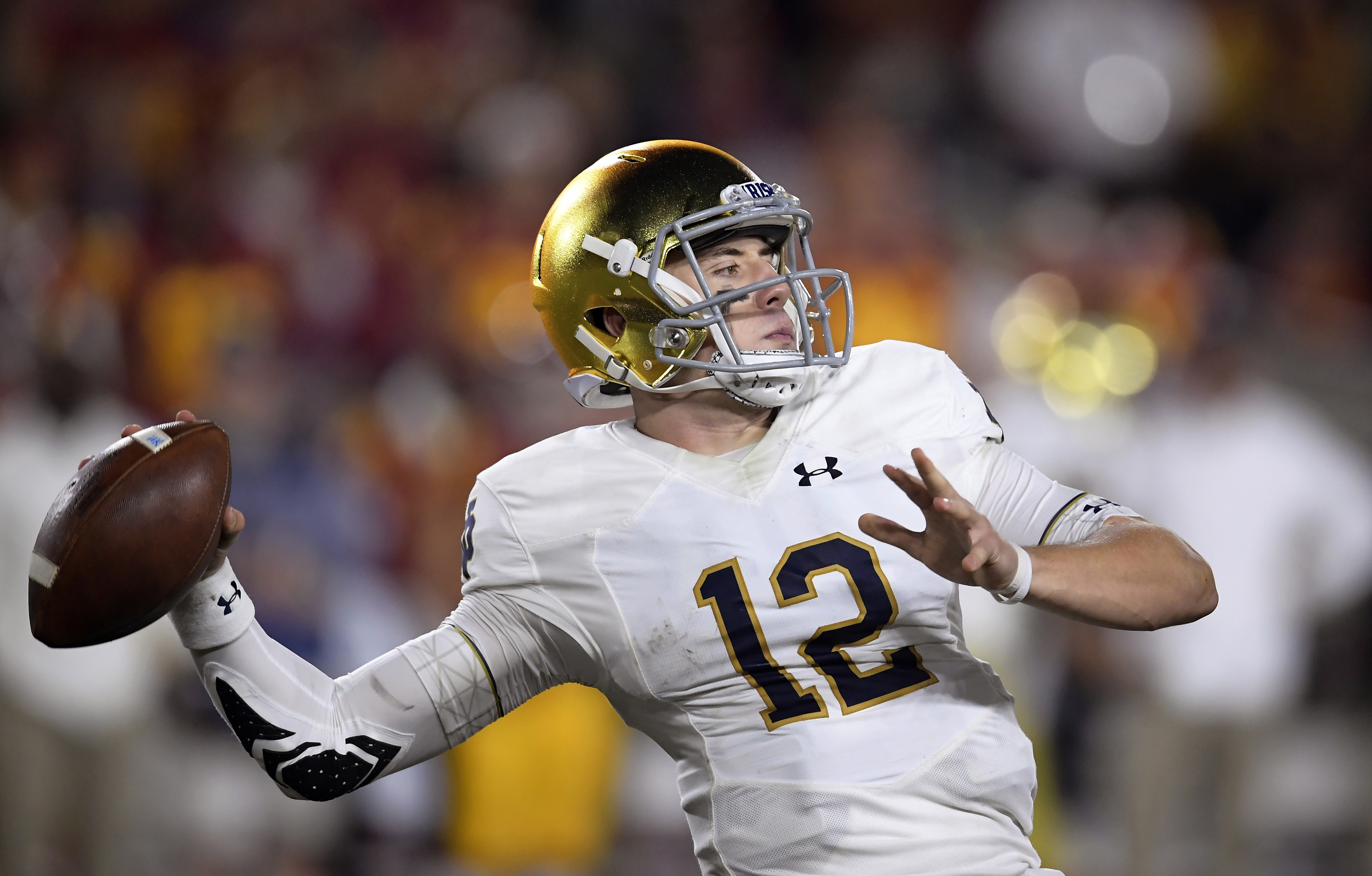 FILE - In this Nov. 24, 2018, file photo, Notre Dame quarterback Ian Book throws a pass during the first half of the team's NCAA college football game against Southern California in Los Angeles. No. 2 Clemson plays No. 3 Notre Dame in the Cotton Bowl on Dec. 29, 2018. (AP Photo/Mark J. Terrill, File)