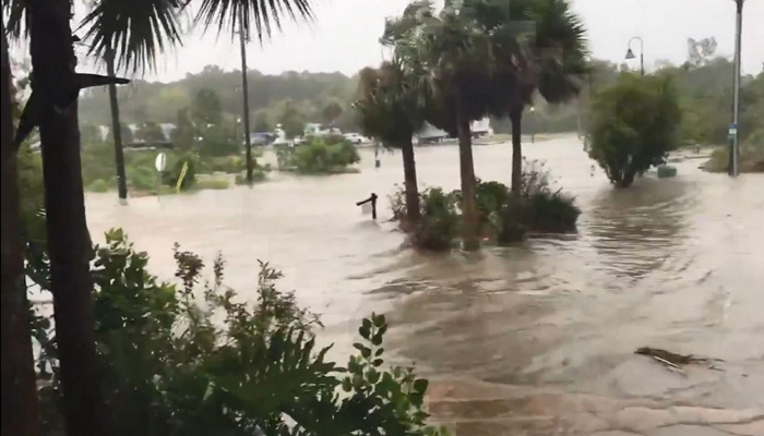 A street in Apalachicola, FL, floods amid storm surge from Hurricane Michael on Wednesday. The storm strengthened to nearly 150 mph before landfall in the Florida Panhandle.