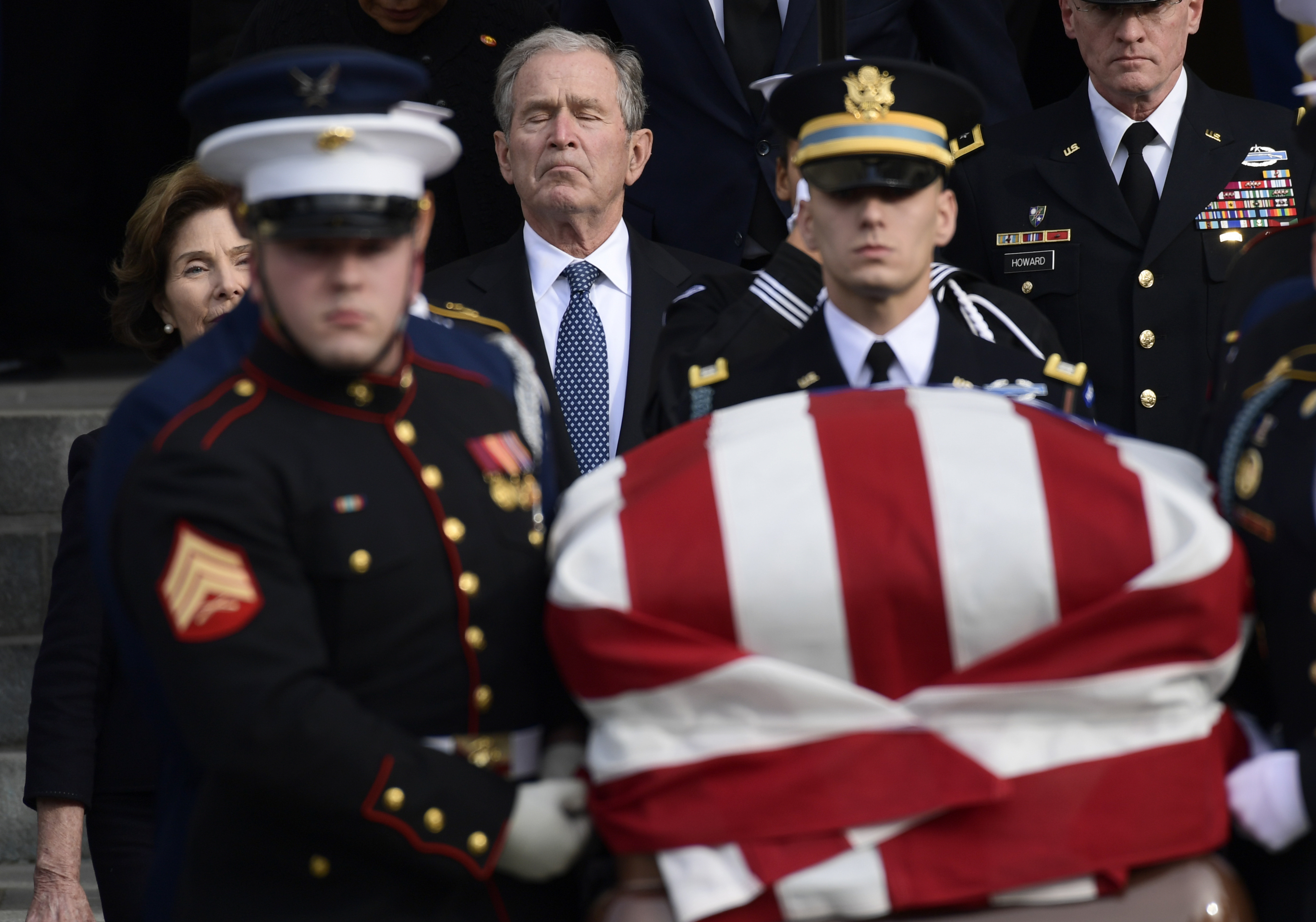 Former President George W. Bush and former first lady Laura Bush, left, follow the casket of former President George H.W. Bush as it is carried out following a State Funeral at the National Cathedral in Washington, Wednesday, Dec. 5, 2018.(AP Photo/Susan Walsh)