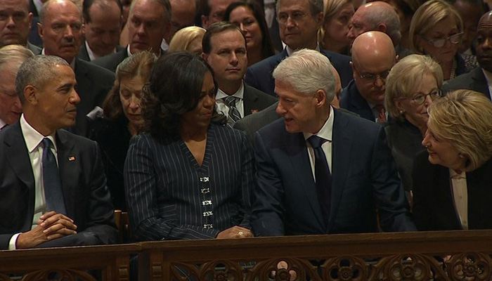 Former President Barack Obama, former first lady Michelle Obama, former President Bill Clinton and former Secretary of State HIllary Clinton await the start of the funeral for former President George H.W. Bush at Washington National Cathedral on Wednesday.
