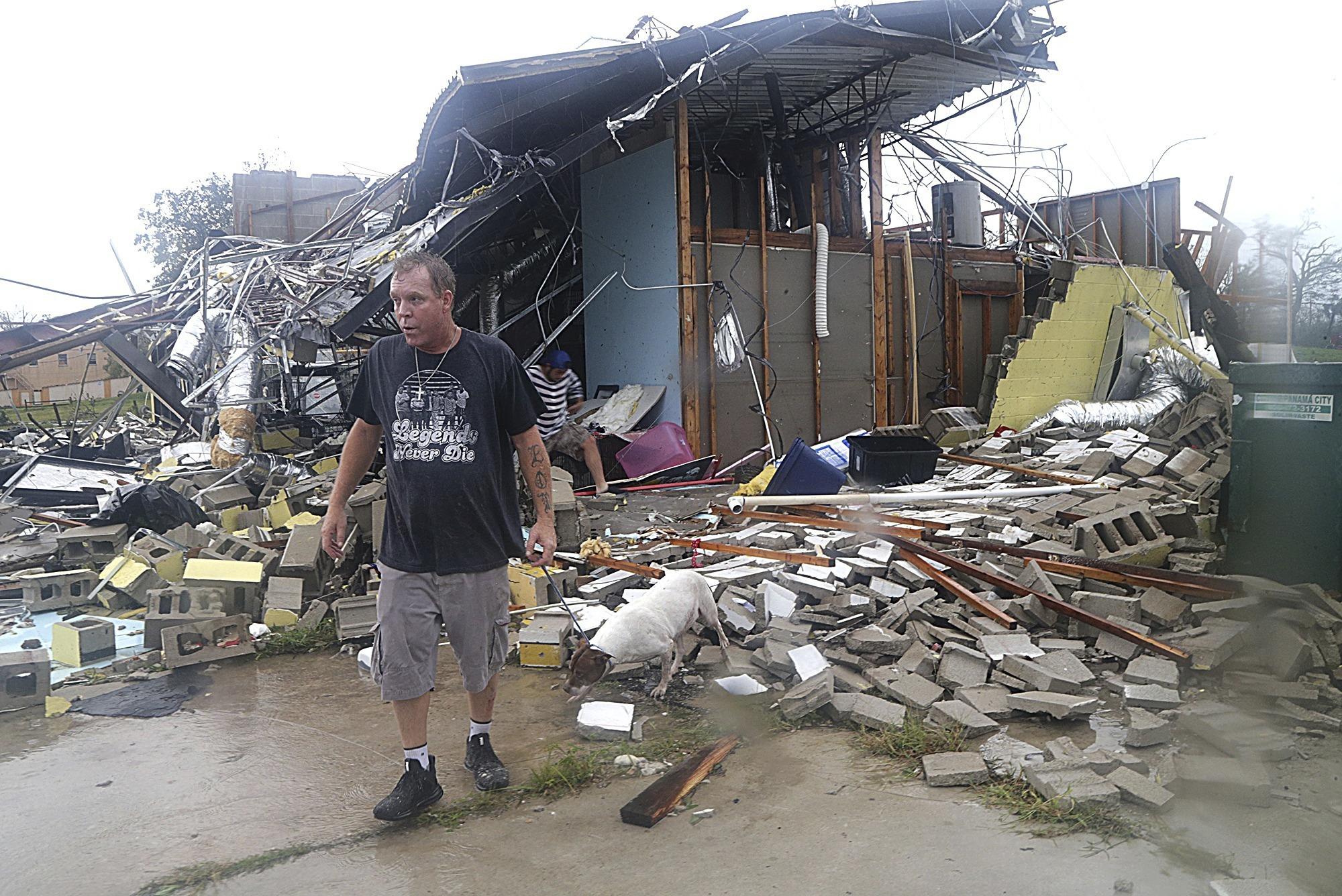 Brian Bon inspects damages in the Panama City downtown area after Hurricane Michael made landfall in Panama City, Fla., Wednesday, Oct. 10, 2018. Supercharged by abnormally warm waters in the Gulf of Mexico, Hurricane Michael slammed into the Florida Panhandle with terrifying winds of 155 mph Wednesday, splintering homes and submerging neighborhoods before continuing its march inland. (Pedro Portal/Miami Herald via AP)