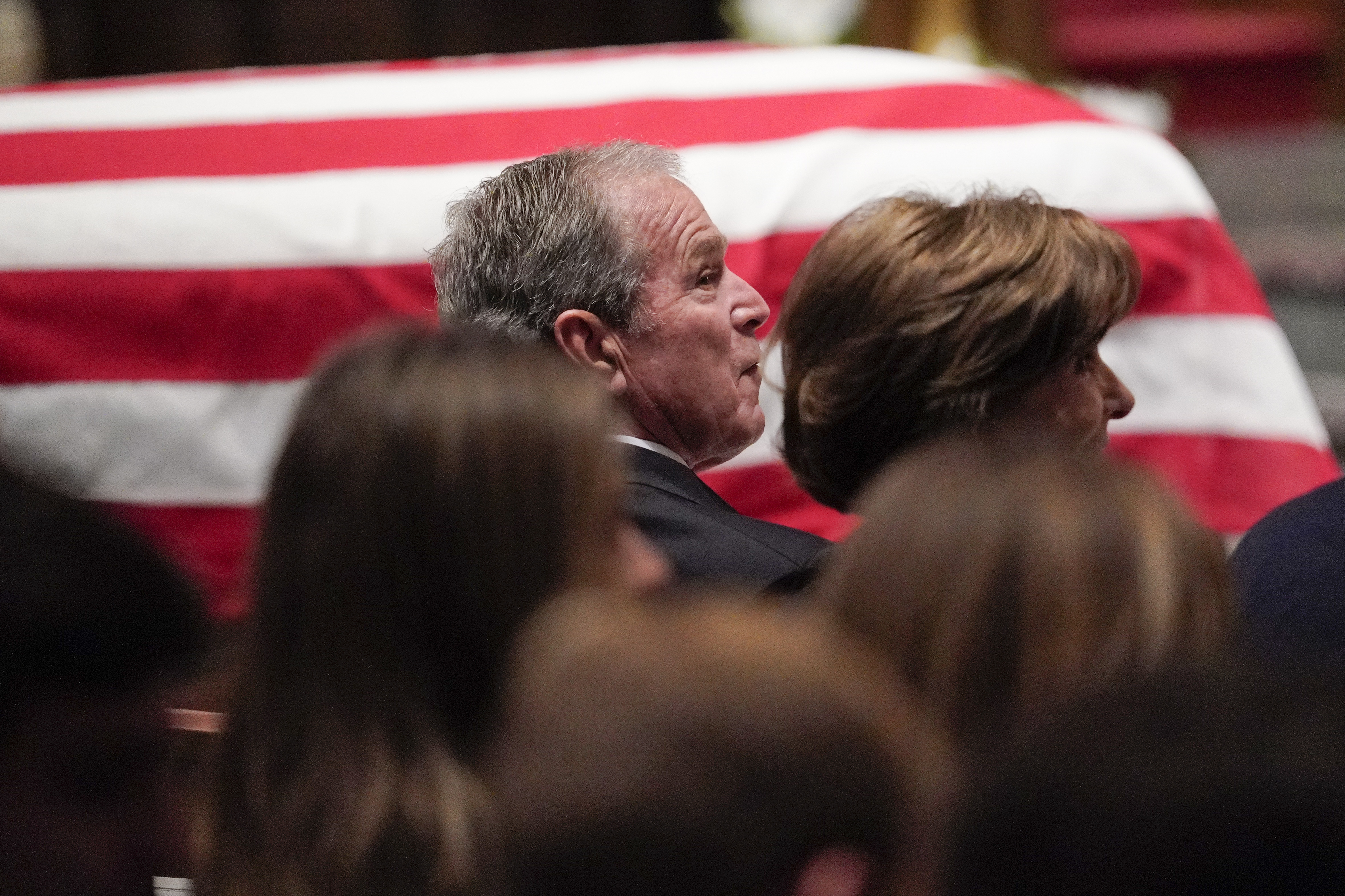 Former President George W Bush And Laura Bush Listen During A Funeral Service For Former