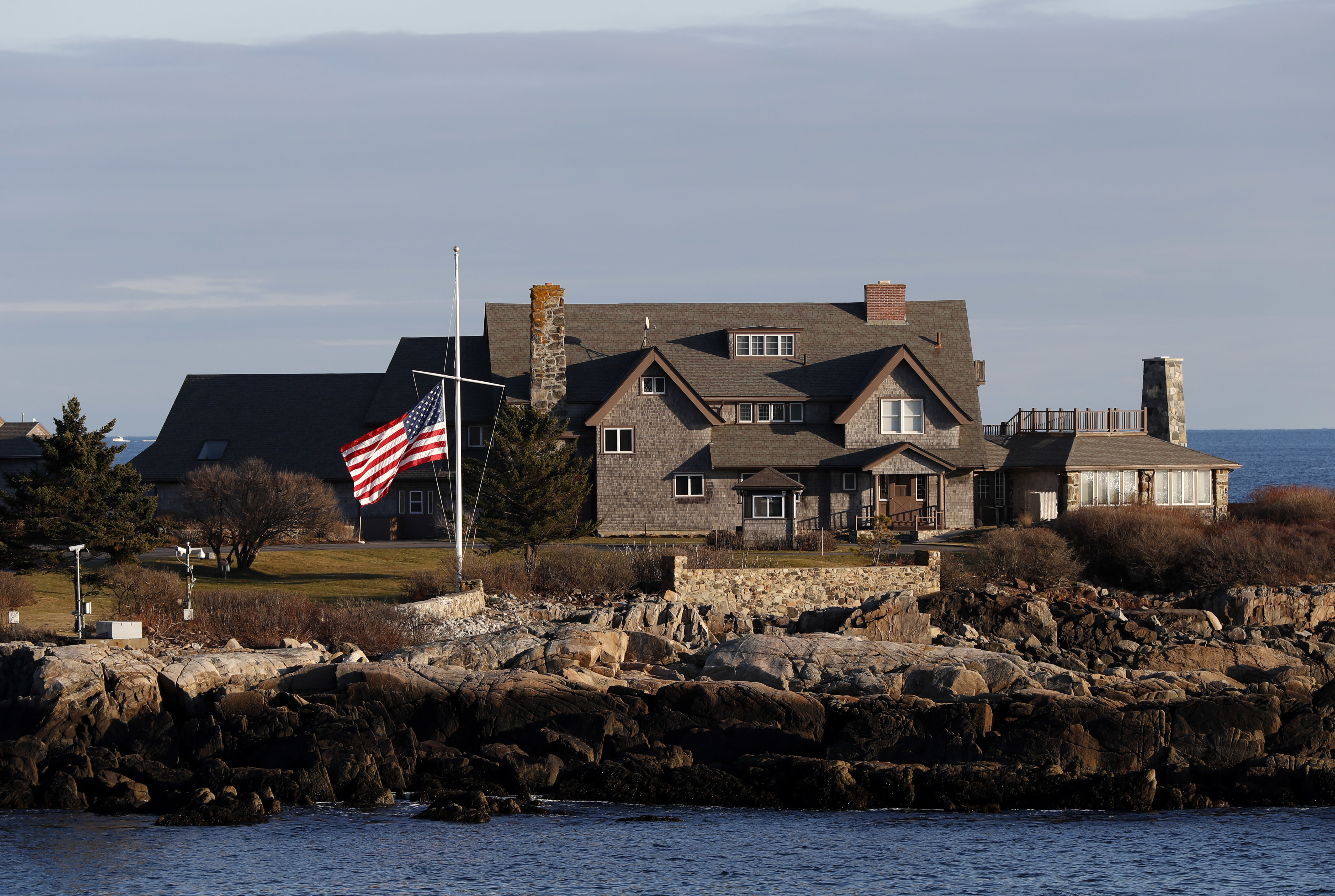 The American flag flies at half-staff in honor of President George H. W. Bush at Walker's Point, the Bush's summer home, Saturday, Dec. 1, in Kennebunkport, Maine. Bush died at the age of 94 on Friday, about eight months after the death of his wife, Barbara Bush. (AP Photo/Robert F. Bukaty)