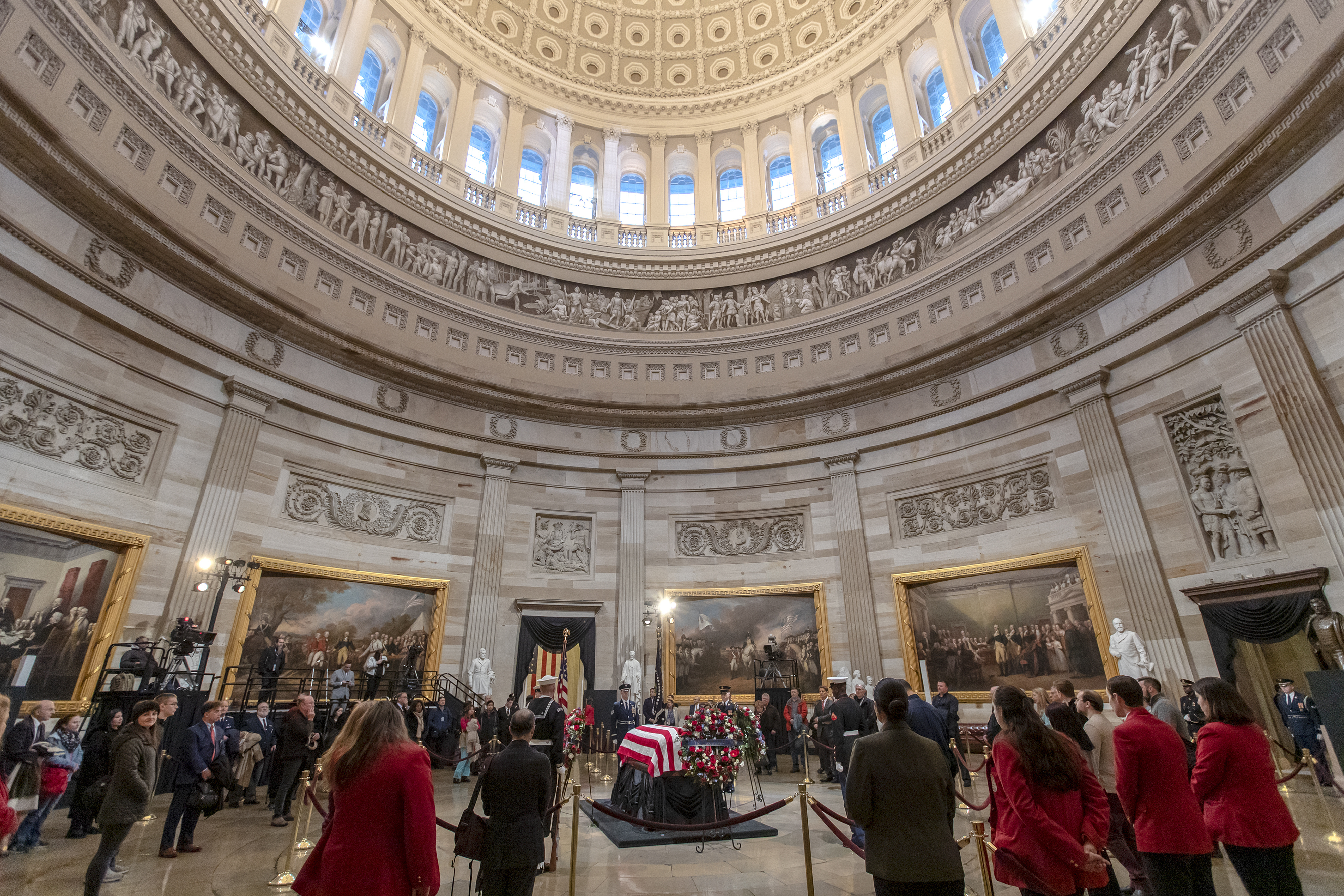 The last visitors pay respects to the late president, George H.W. Bush, as the public viewing comes to an end at the U.S. Capitol Rotunda, Wednesday, Dec. 5, 2018. (AP Photo/J. Scott Applewhite)
