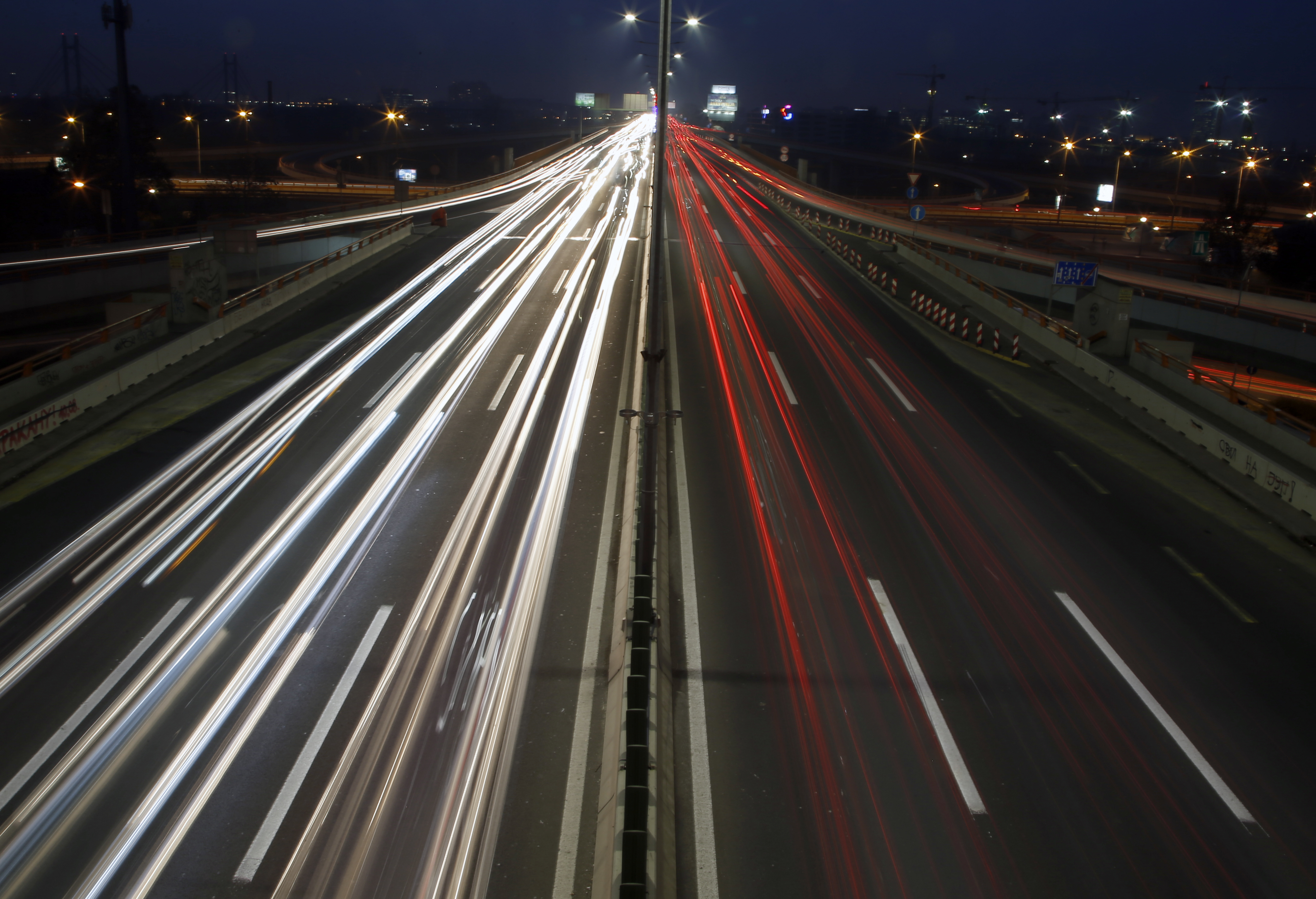 In this image taken with a slow shutter speed, vehicles move on a road in Belgrade, Serbia, Monday, Dec. 3, 2018. The COP24 UN Climate Change Conference is taking place in Katowice, Poland. Negotiators from around the world are meeting for talks on curbing climate change. (AP Photo/Darko Vojinovic)