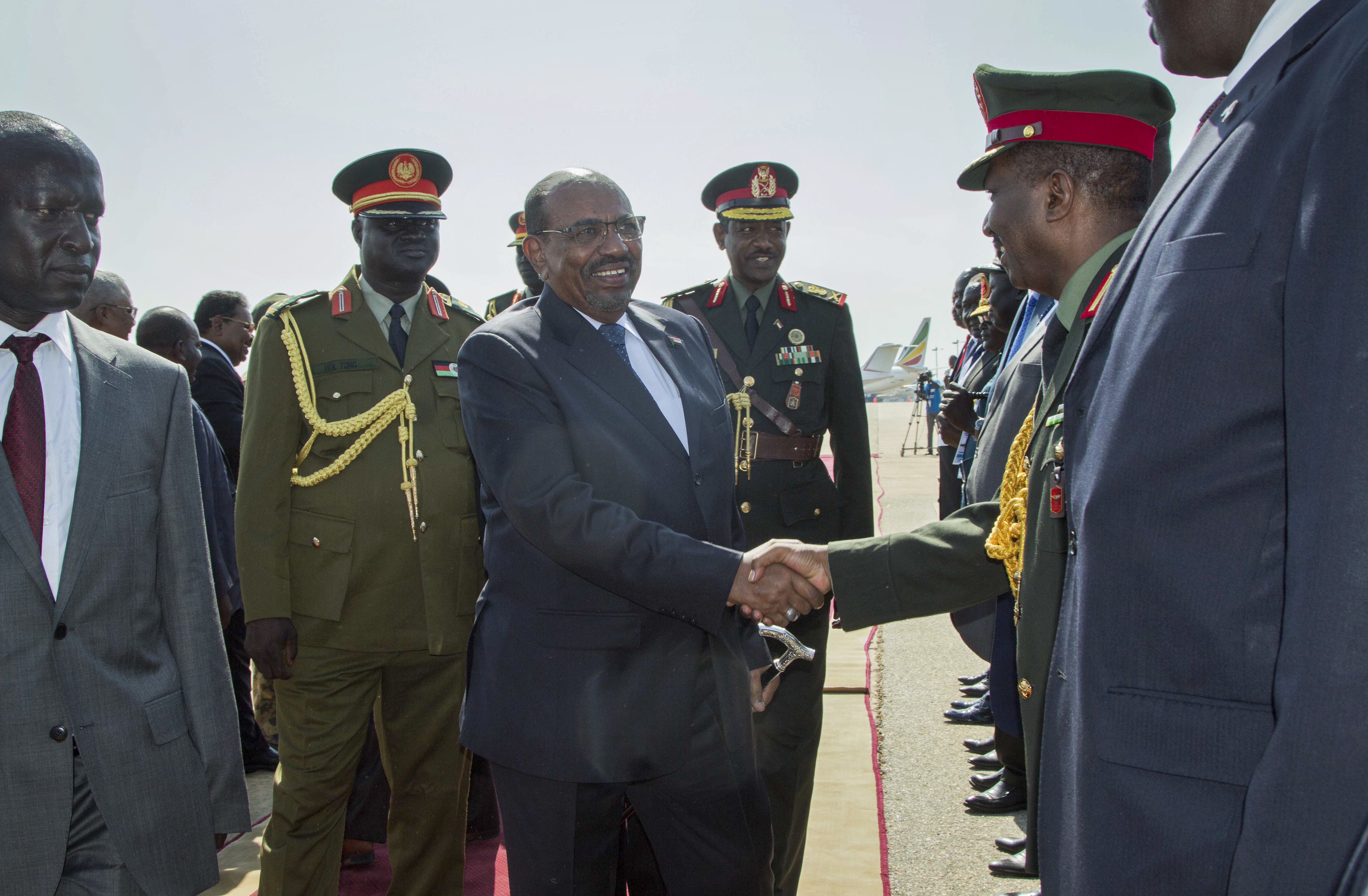 Sudan's President Omar al-Bashir, center, greets dignitaries as he arrives at the airport in Juba, South Sudan Wednesday, Oct. 31, 2018. For the first time since fleeing the war-torn country more than two years ago, South Sudan's opposition leader Riek Machar returned on Wednesday to take part in a nationwide peace celebration. (AP Photo/Bullen Chol)